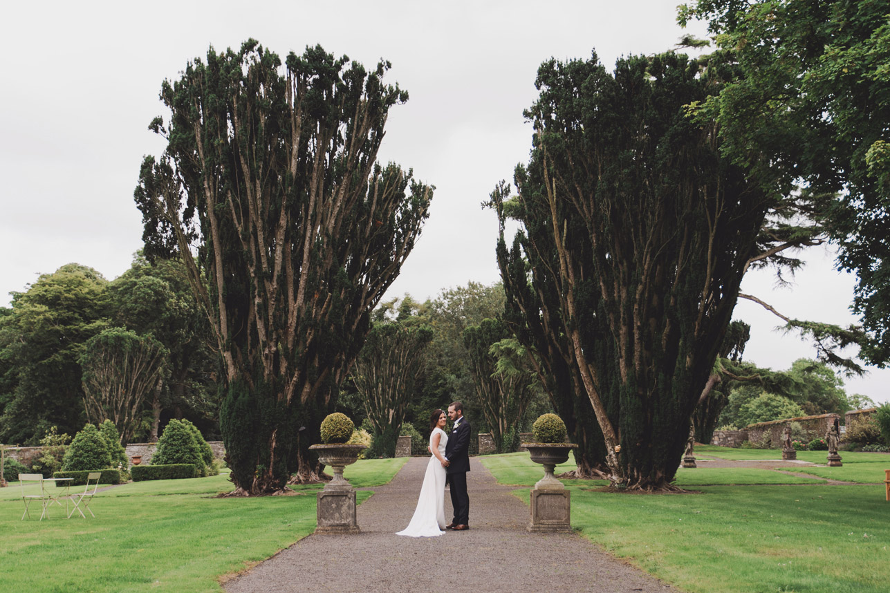 Bride and groom walking in Tankardstown House Gardens Co Meath Wedding photography meath ireland