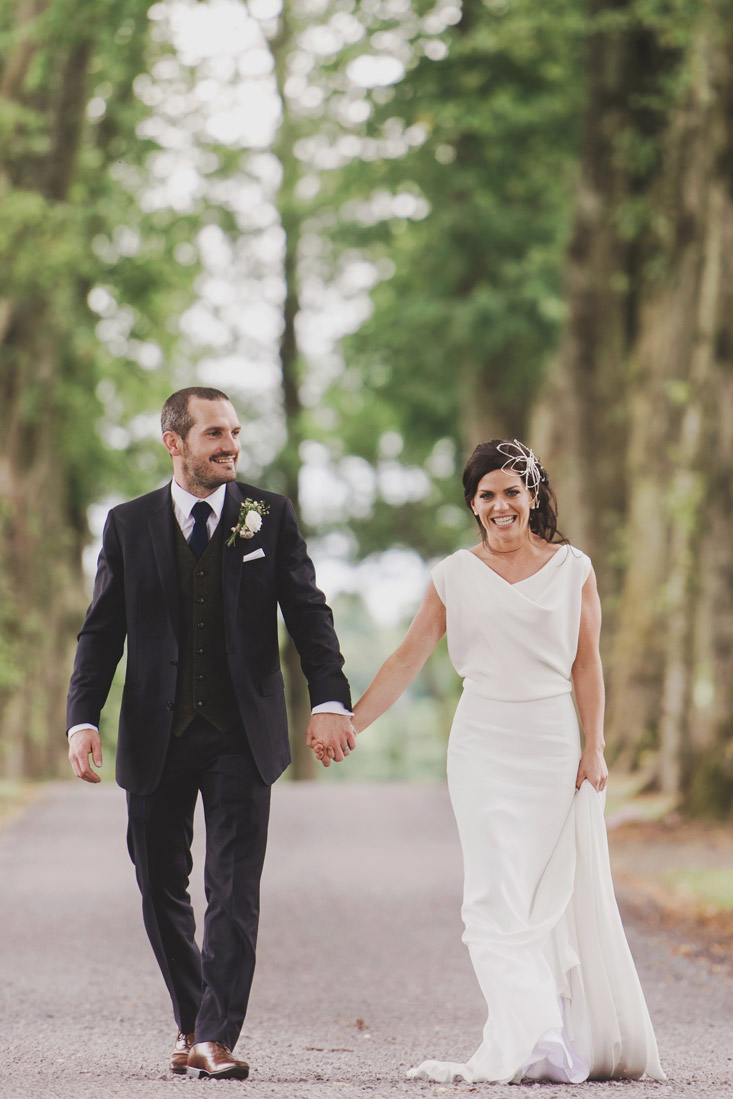 Bride and groom holding hands in Tankardstown House Meath Wedding photographers meath ireland