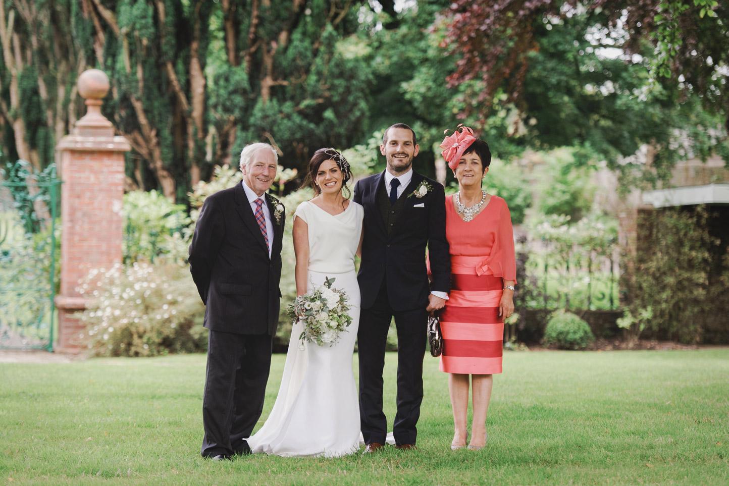 Group photo in Tankardstown House Meath Wedding photographers meath ireland