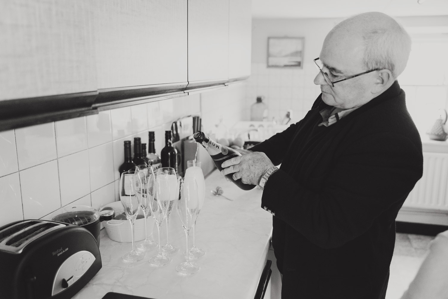 Father of the bride pouring champagne wedding photography meath