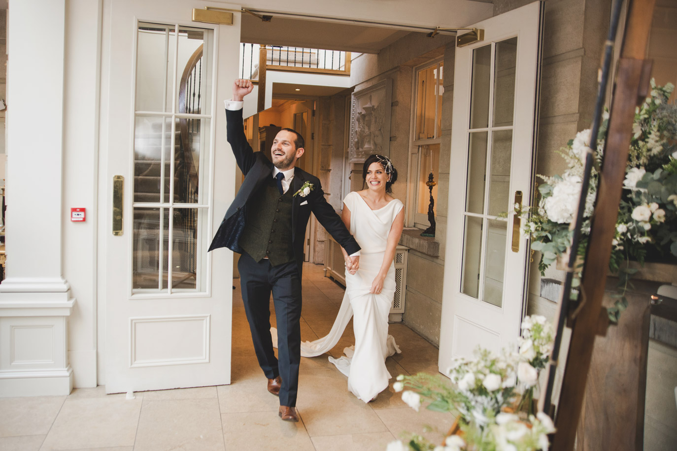 Bride and groom entering dining room in Tankardstown House Meath Wedding photographers meath ireland