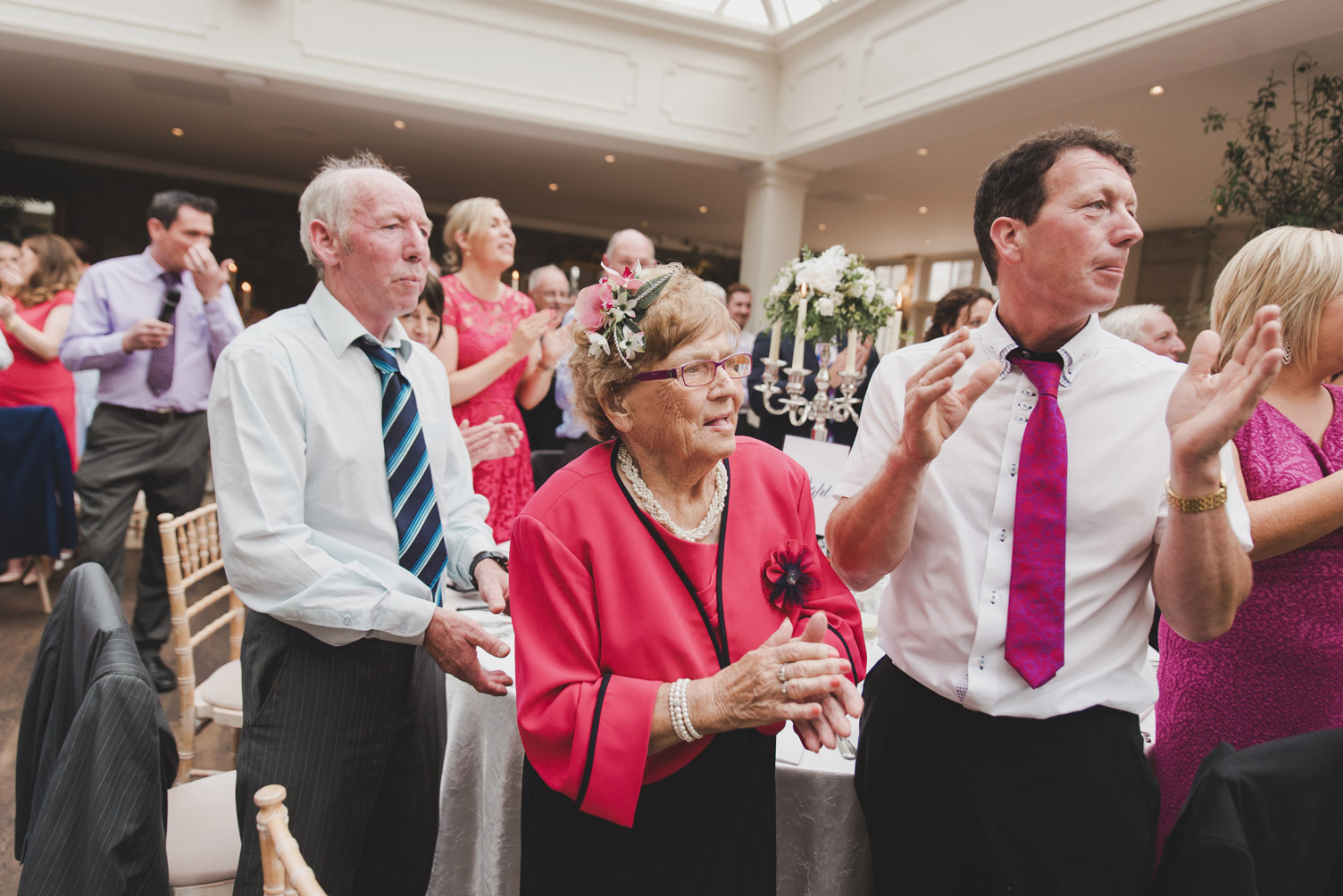 Guests clapping in Tankardstown House Meath Wedding photographers meath ireland