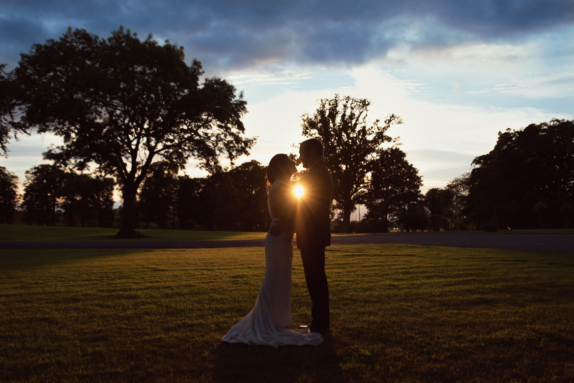 Bride and groom at sunset in Tankardstown House Meath Wedding photographers meath ireland