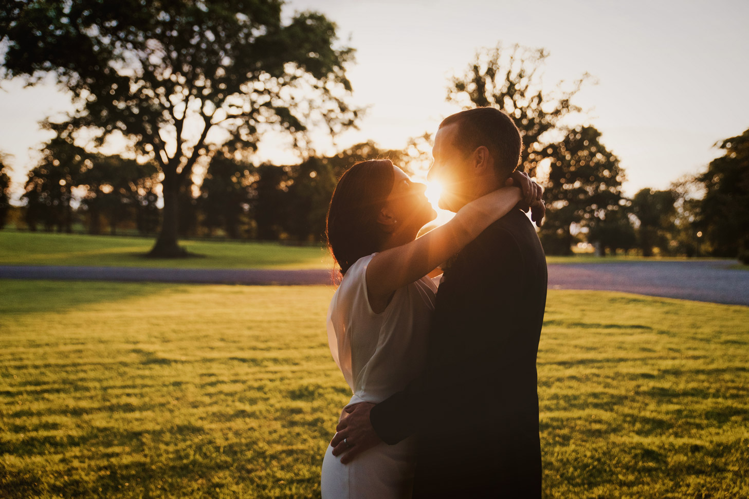 Bride and groom kissing at sunset in Tankardstown House Meath Wedding photographers meath ireland