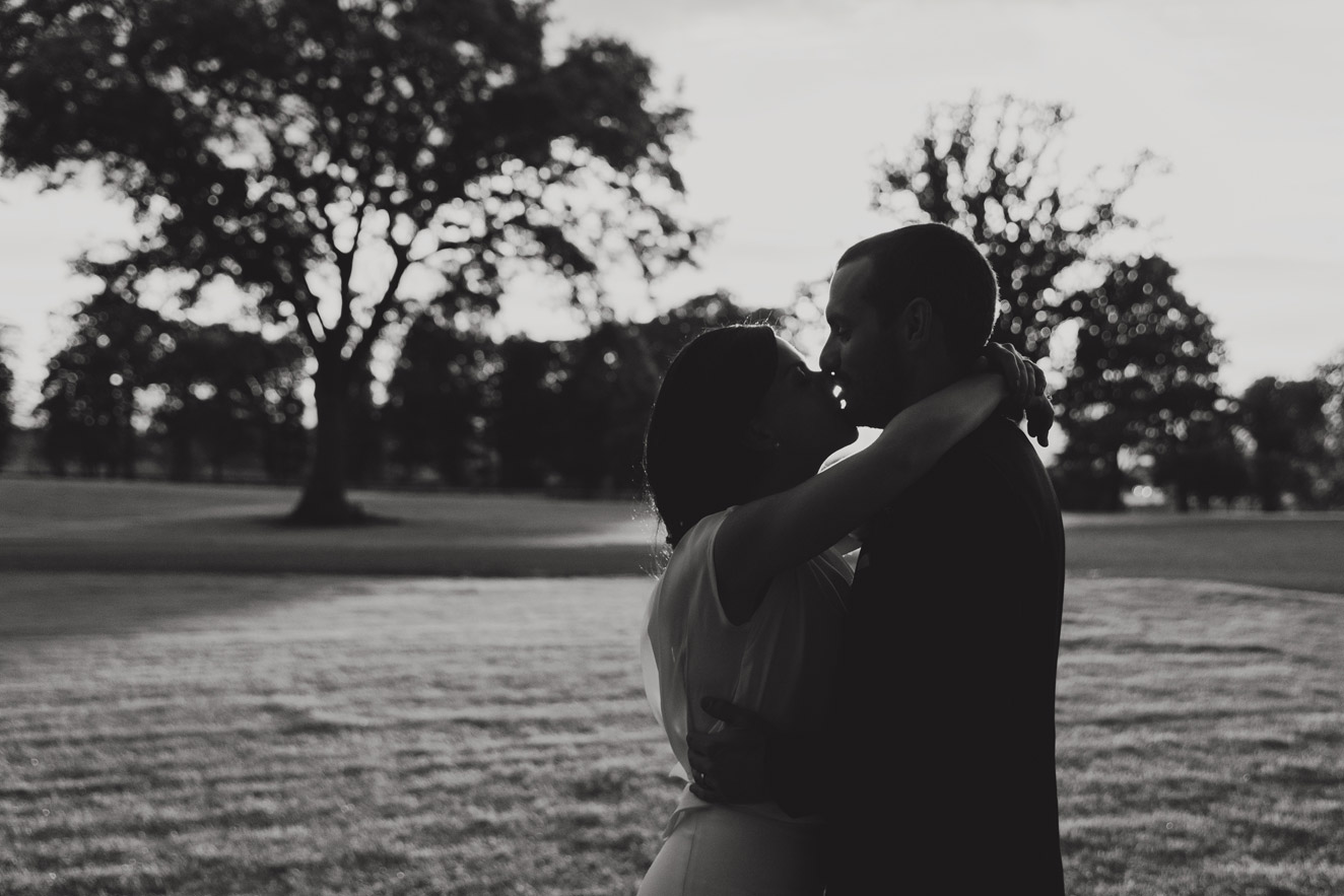 Bride and groom kissing at sunset in black and white at Tankardstown House Meath Wedding photographers meath ireland