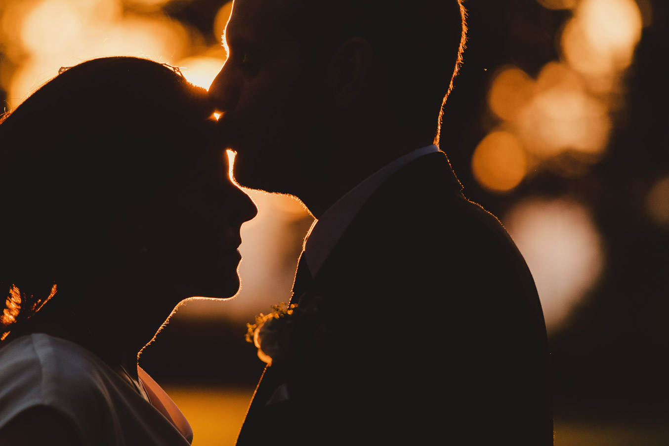Bride and groom silhouette at sunset in Tankardstown House Meath Wedding photographers meath ireland