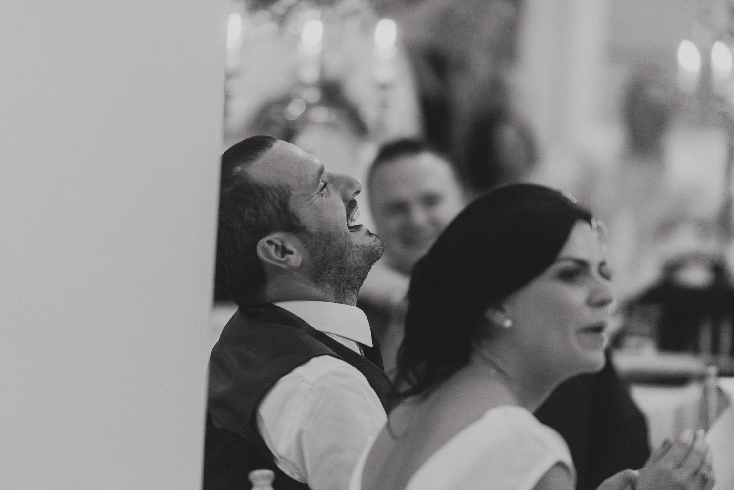 Groom laughing in Tankardstown House Meath Wedding photographers meath ireland