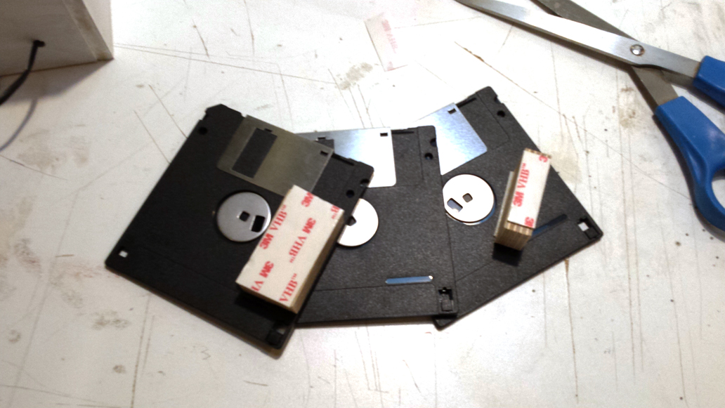 Attaching the Simcity 2000 3.5in Floppy Disks together with 3M VHB double sided tape