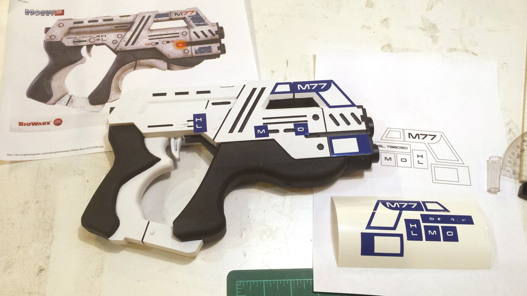 3D Printed Cosplay Mass Effect Pistol with detailed vinyl mask applied
