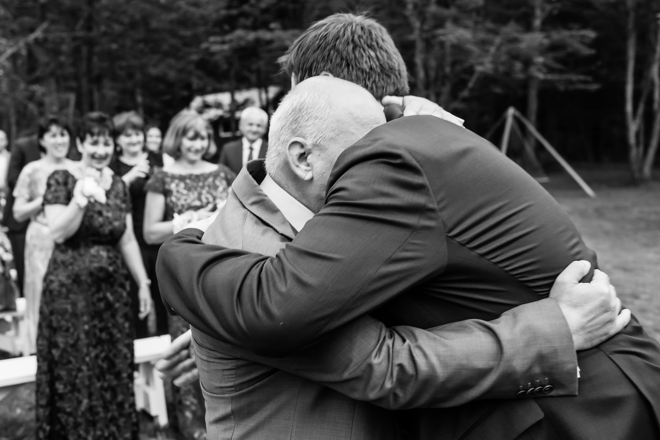 Stefy Hilmer Photography - father of the bride hugs grooom after walking down the aisle .jpg