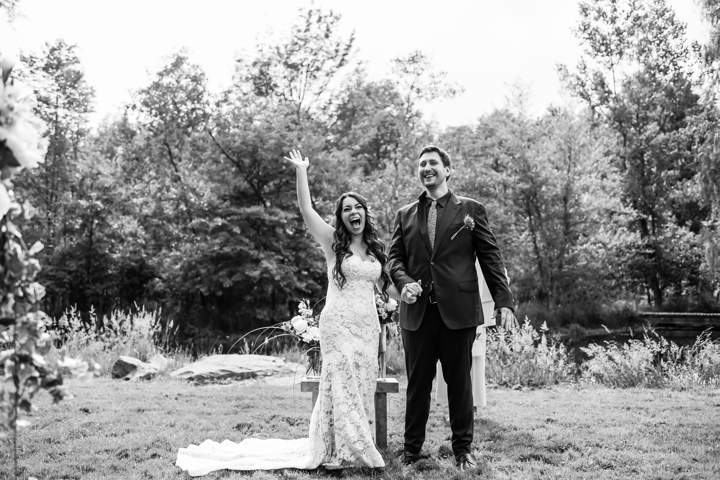 Stefy Hilmer Photography -bride and groom cheering after they said i do.jpg