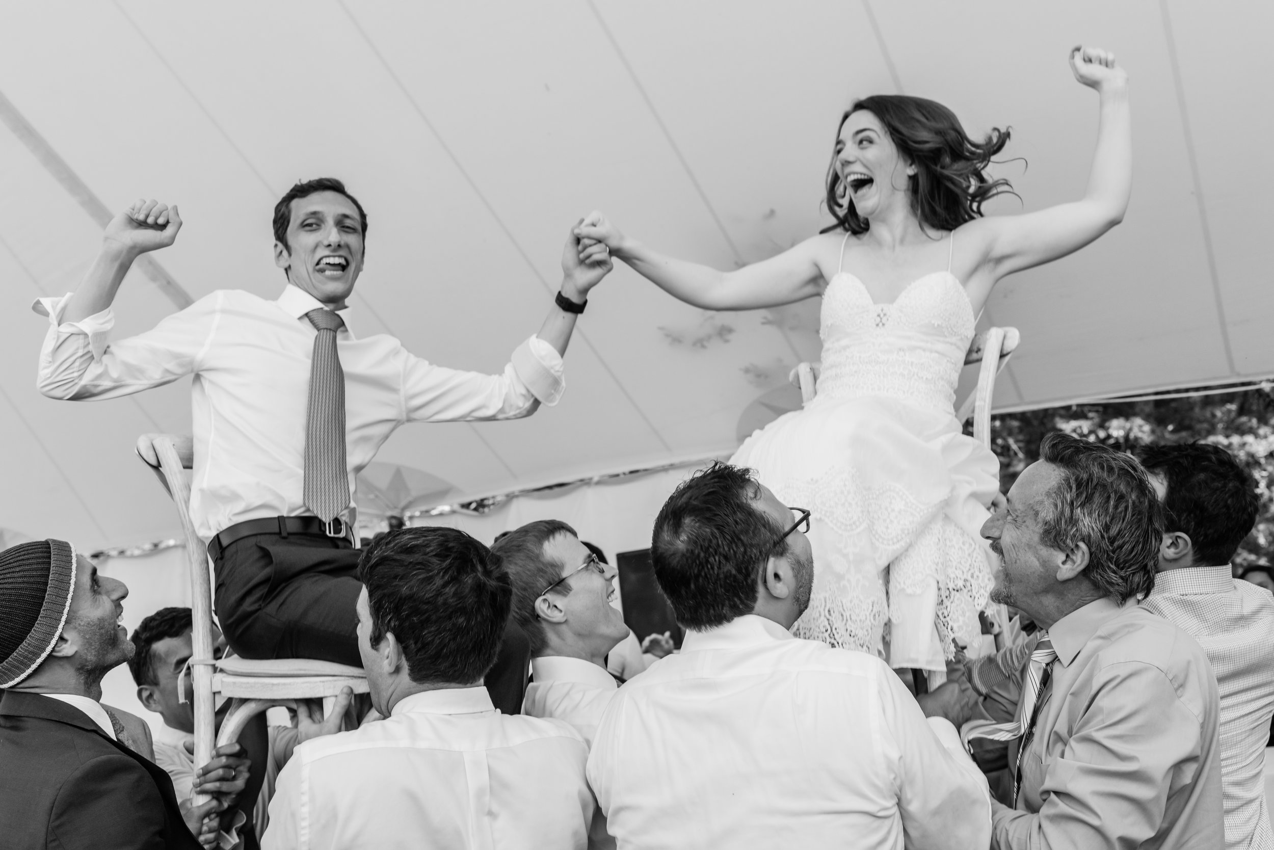 Stefy Hilmer Photograhy- bride and groom up on the chair during the horah dance.jpg