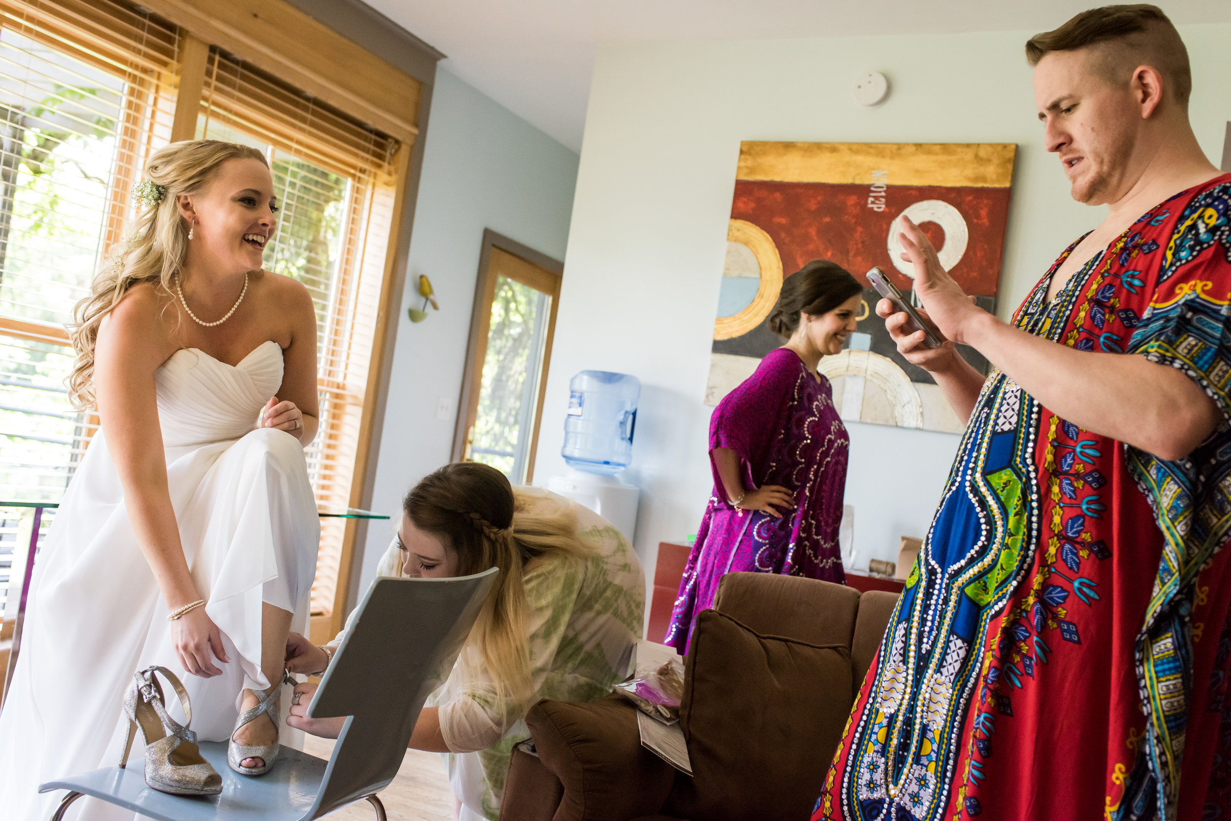Stefy Hilmer Photography- bride is putting wedding shoes on.jpg