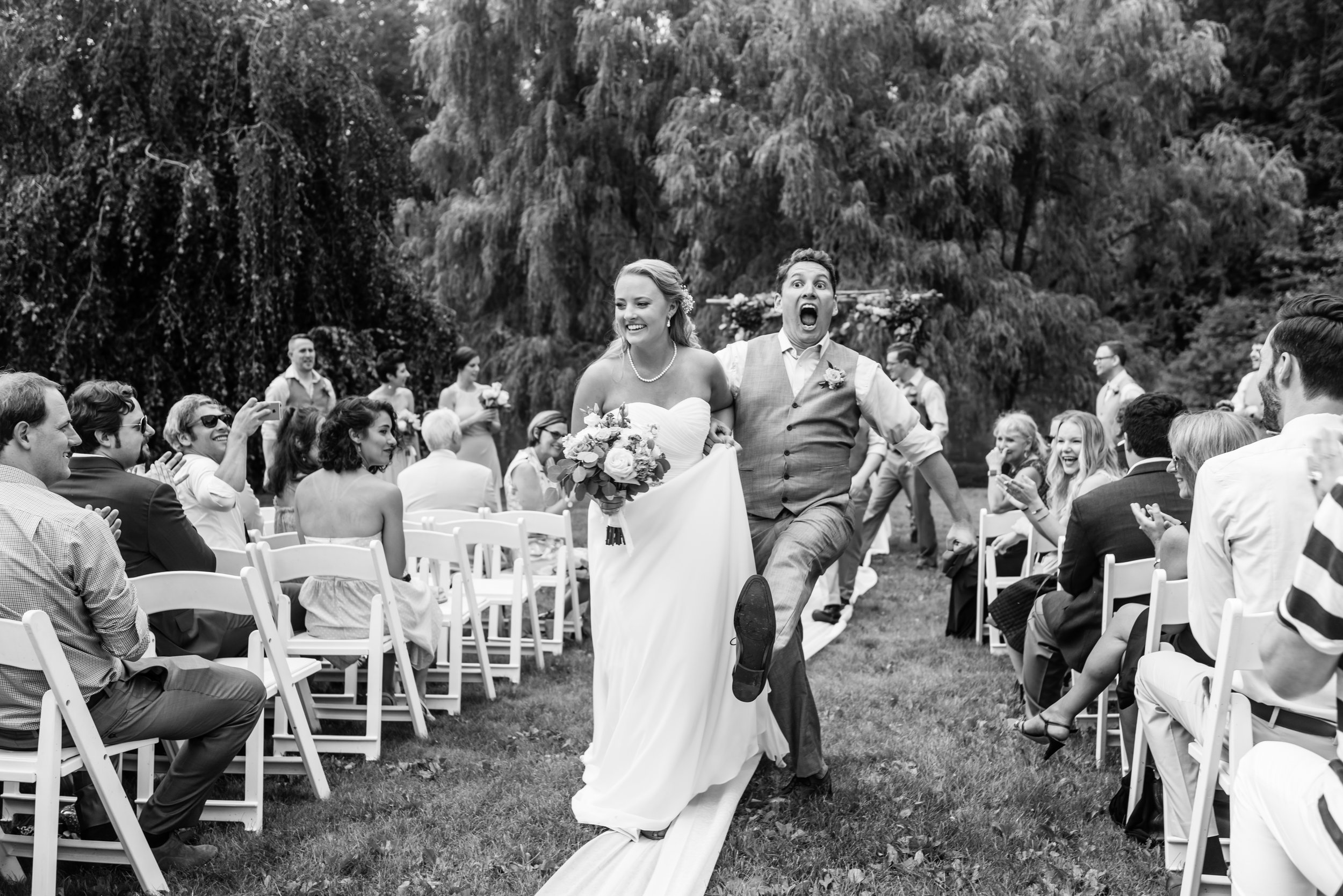 Stefy Hilmer Photography- funny photo of bride and groom receeding down the aisle.jpg