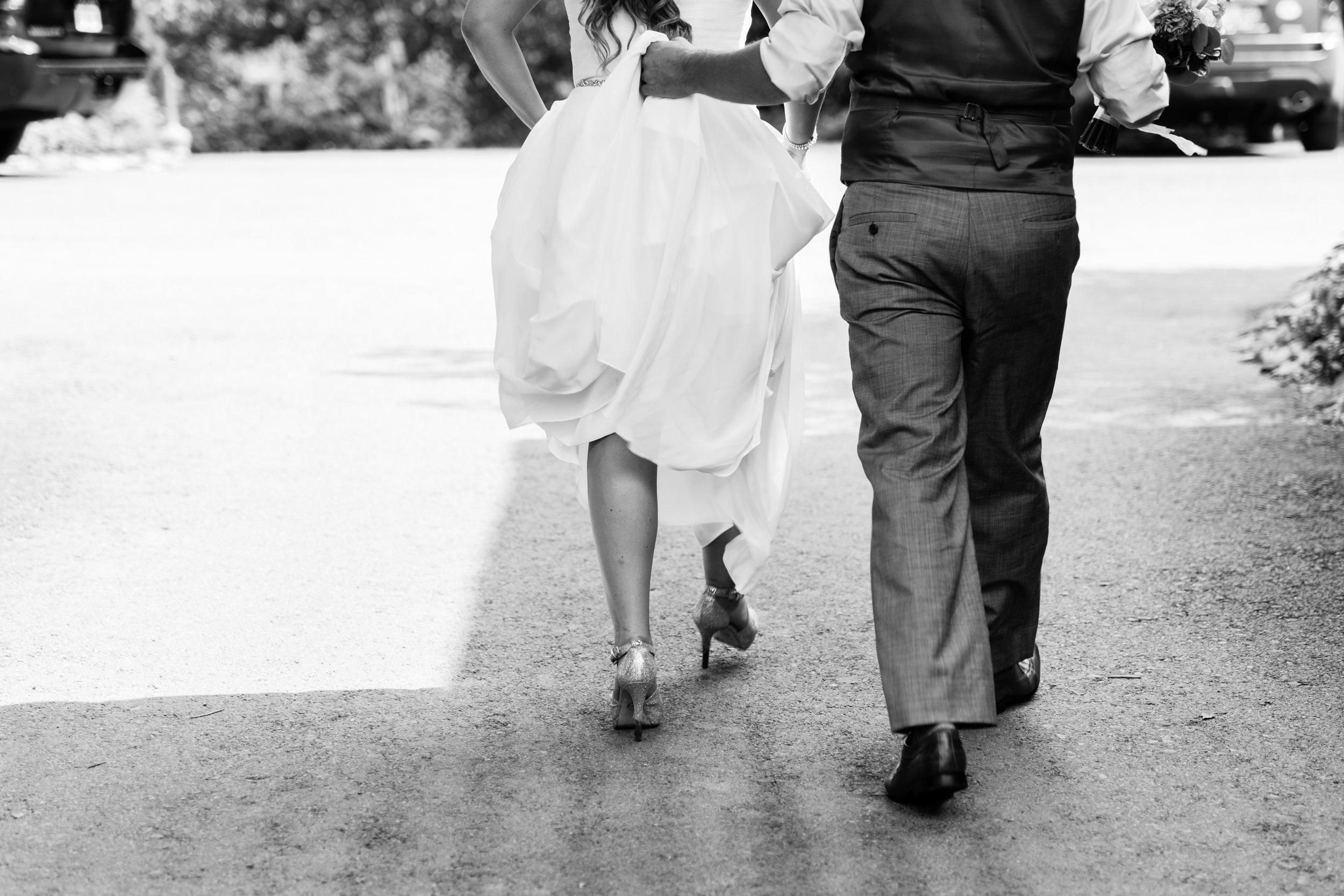 Stefy Hilmer Photography- groom helping bride keeping her dress clean.jpg