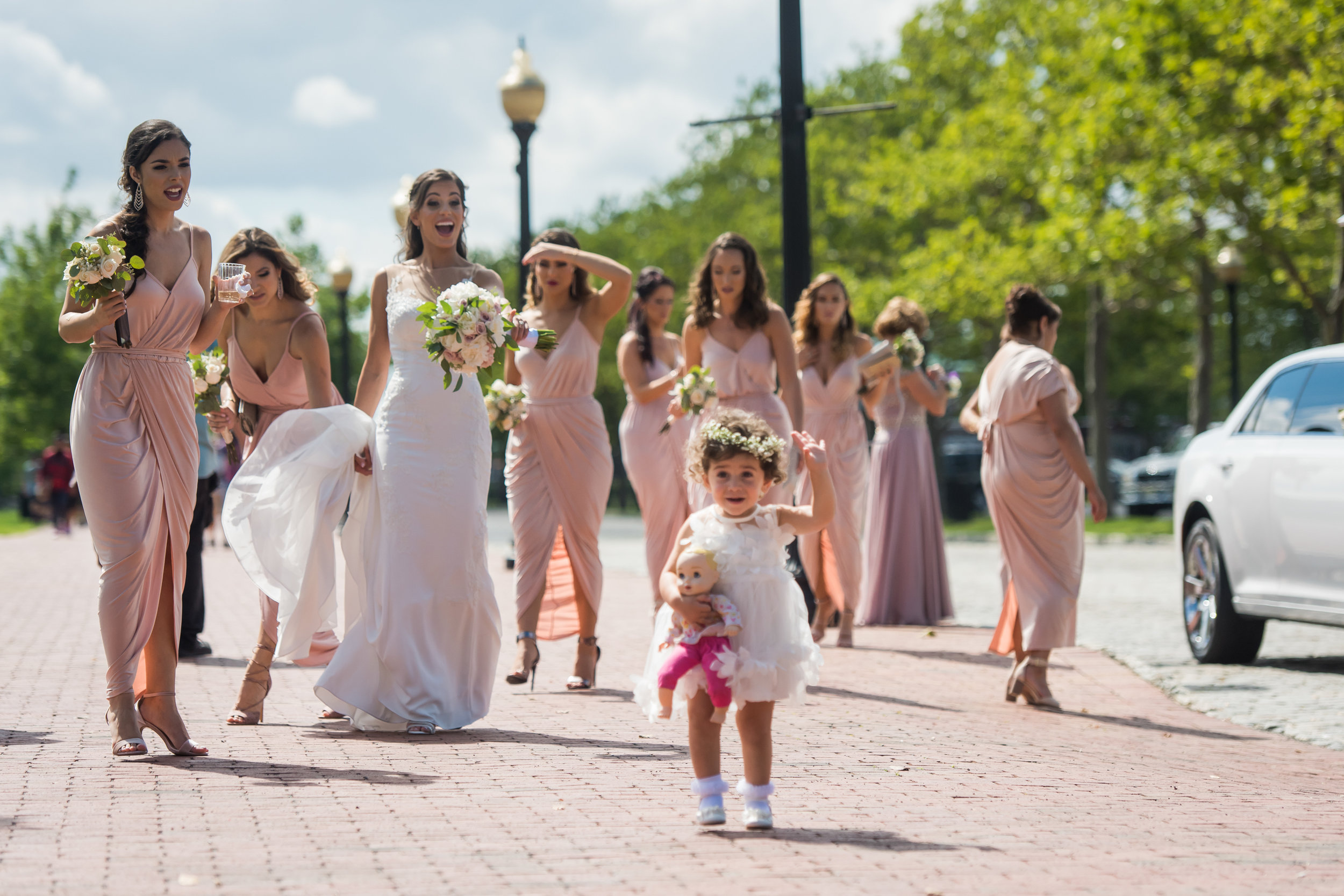 Stefy Hilmer Photography-bride and bridesmaid on their way to the formal portraits.jpg