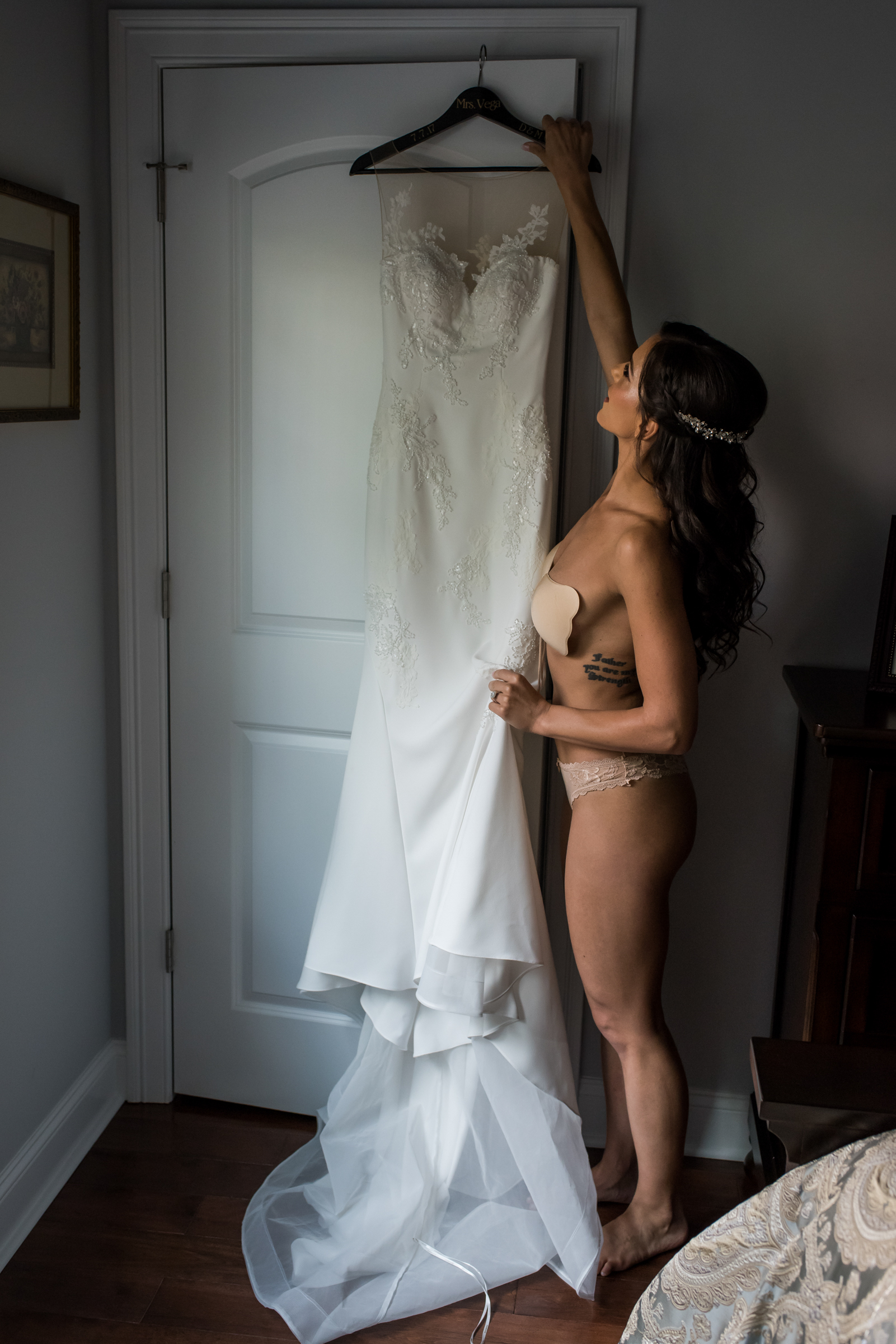 Stefy Hilmer Photography-bride is getting into her wedding dress.jpg