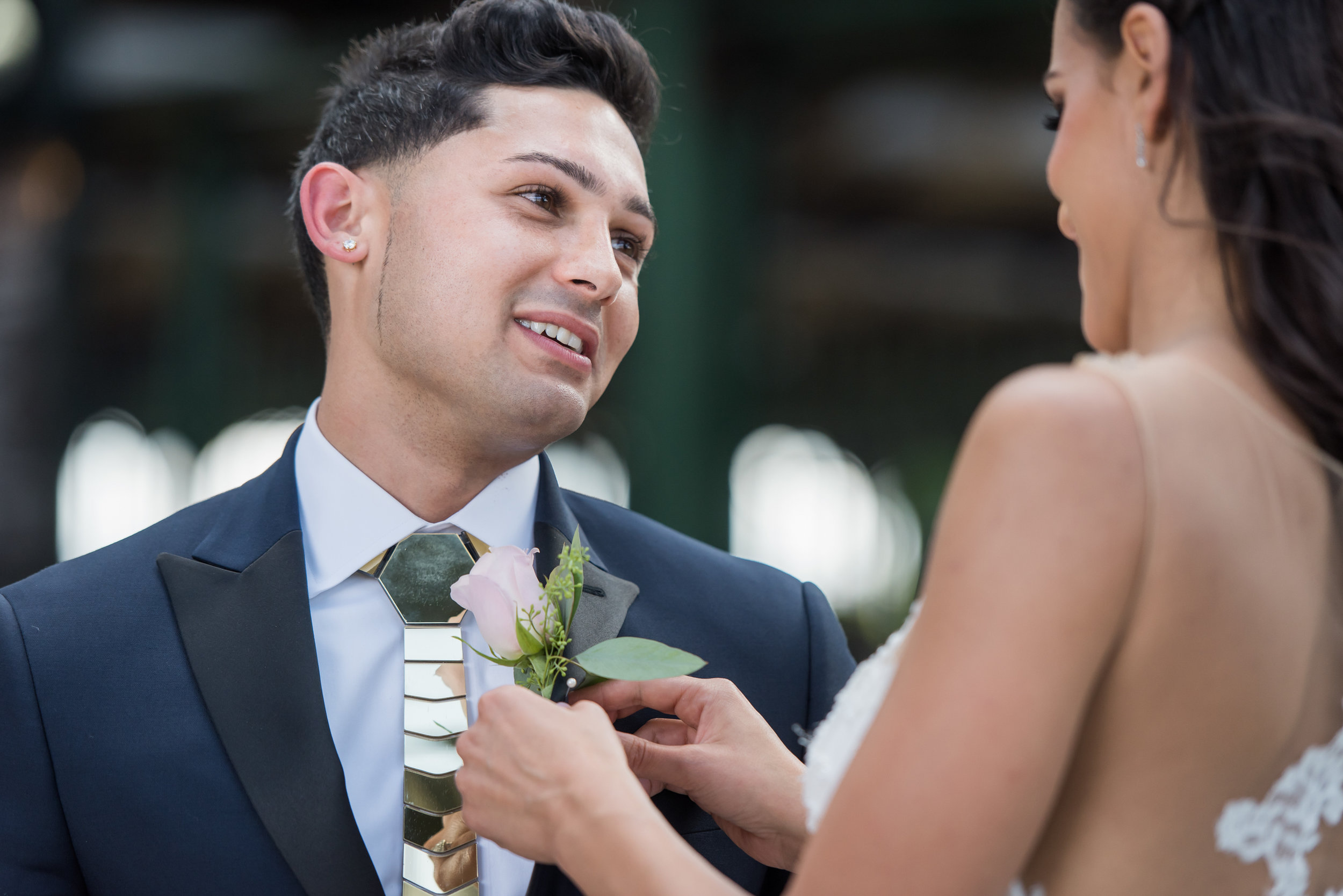 Stefy Hilmer Photography-bride is helping groom with the boutonniere.jpg
