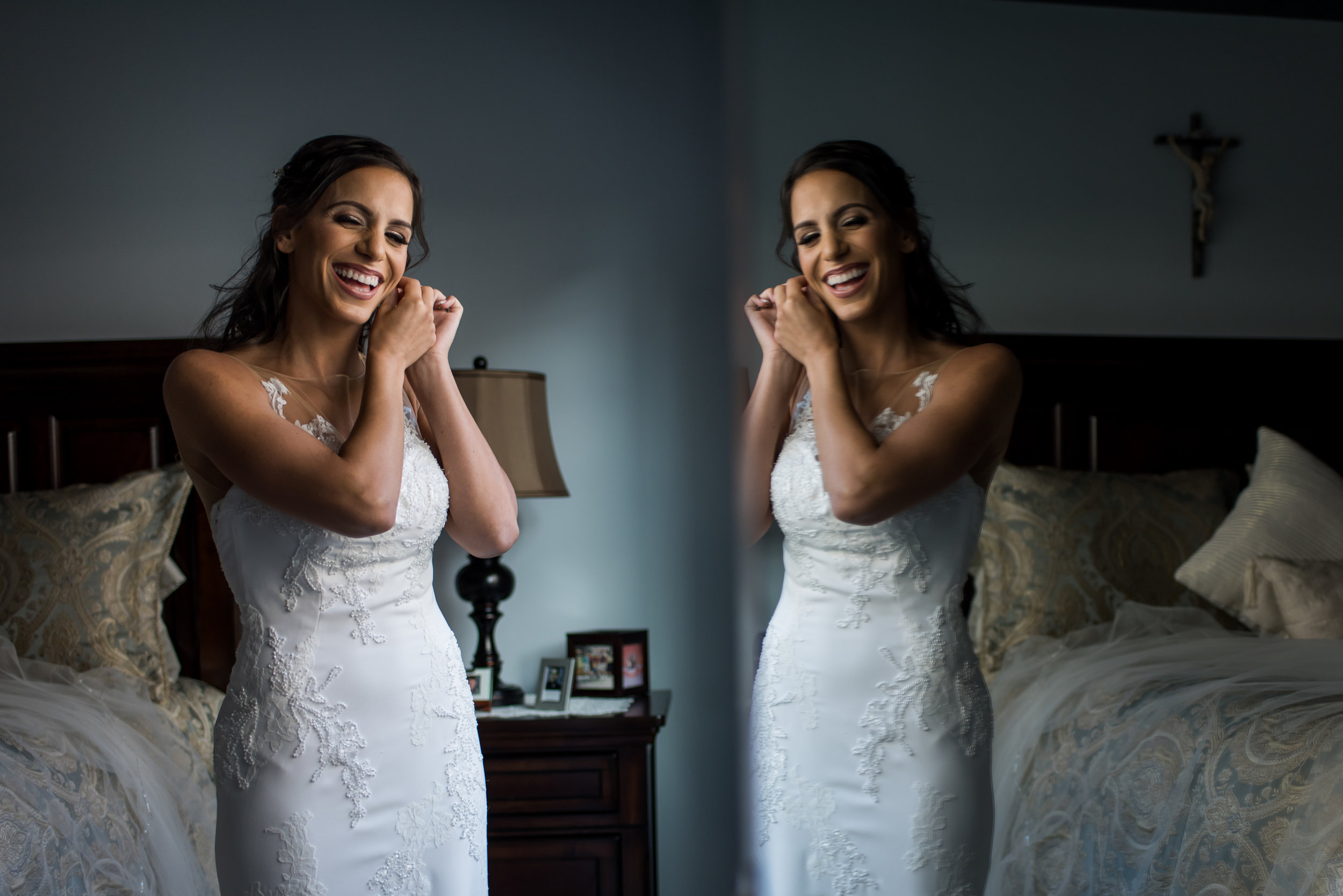 Stefy Hilmer Photography-bride is putting on earings.jpg