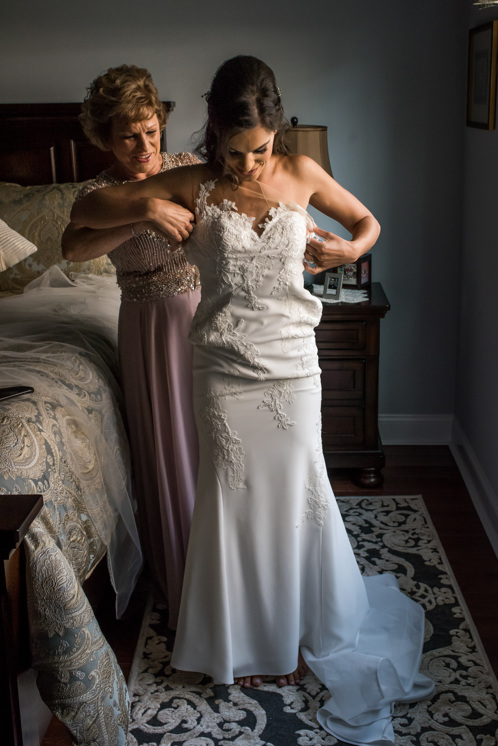 Stefy Hilmer Photography-mom is helping bride into the dress on her wedding day.jpg