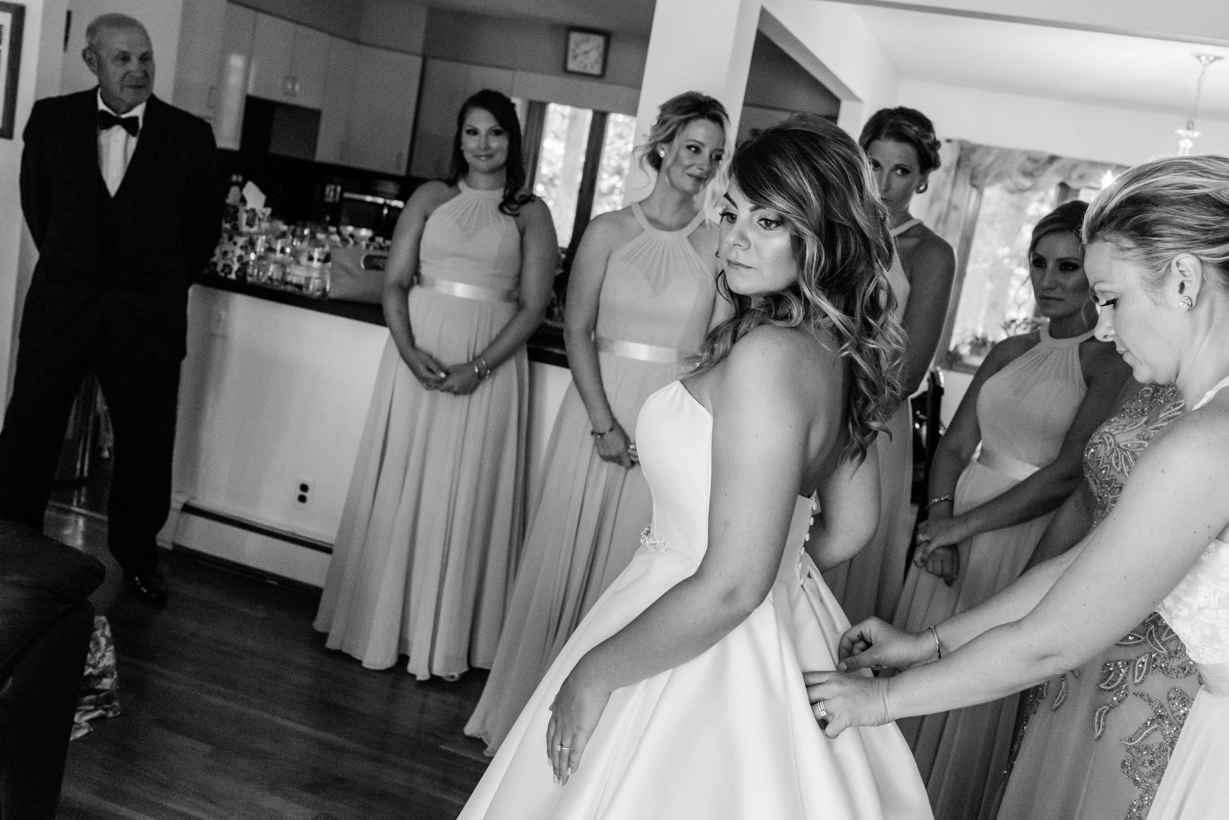 Stefy Hilmer Photography-bride getting into her dress on her wedding day.jpg
