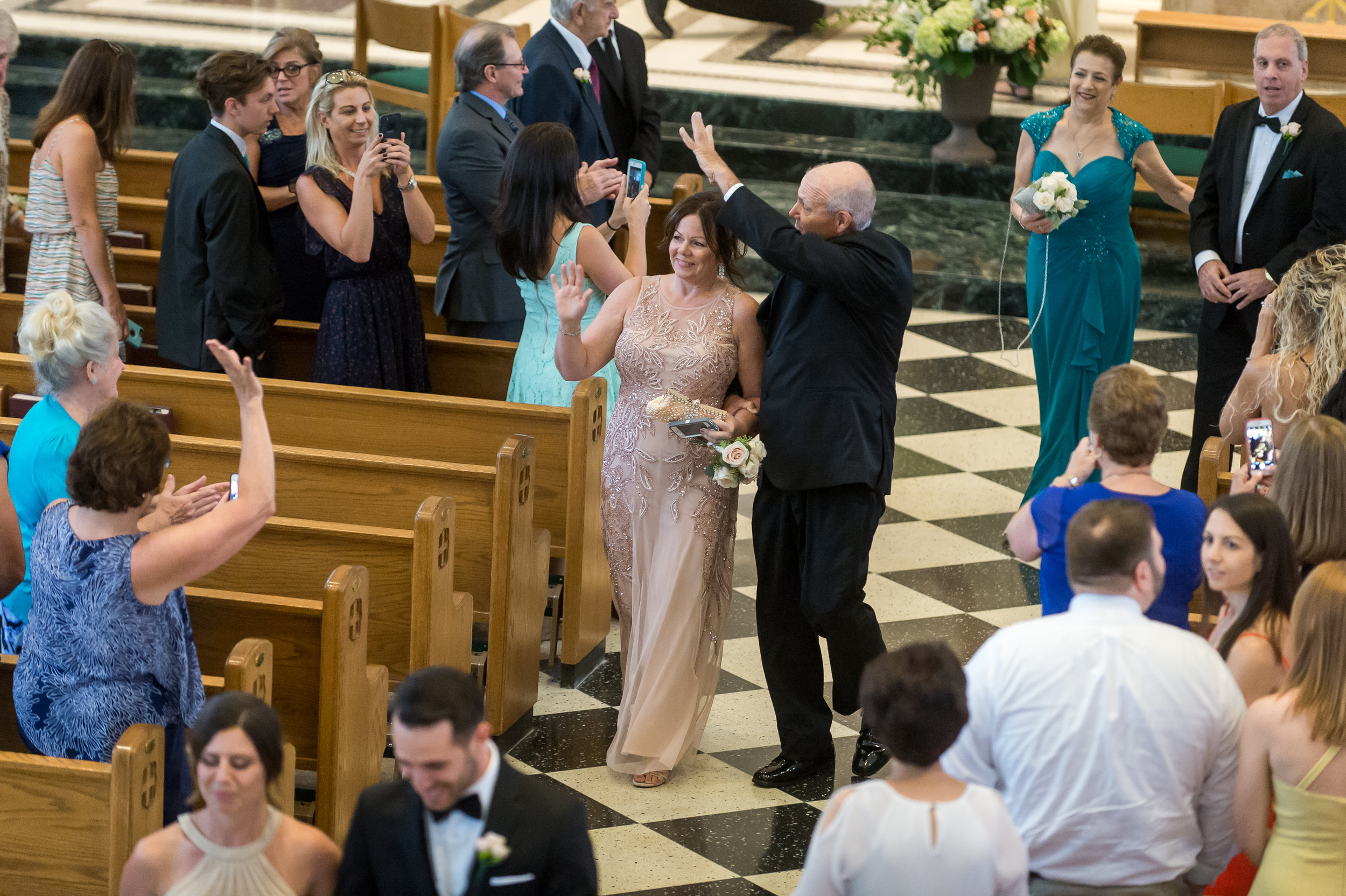 Stefy Hilmer Photography-parents of the bride waving in church after ceremony.jpg