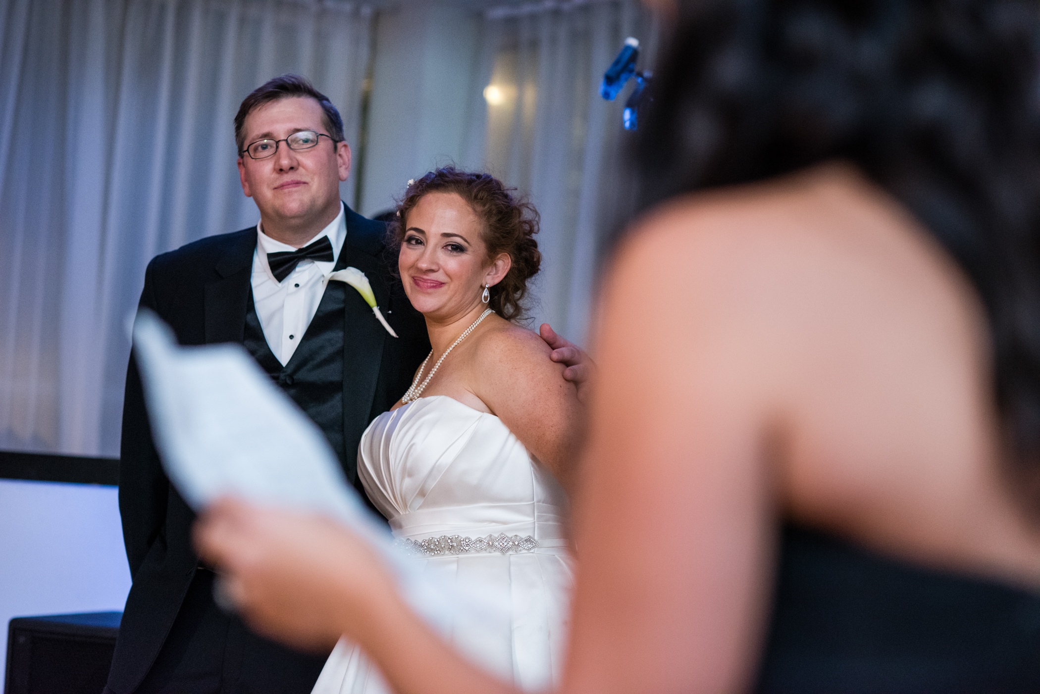 Stefy Hilmer Photography-bride and groom listening to bridesmaid speech.jpg