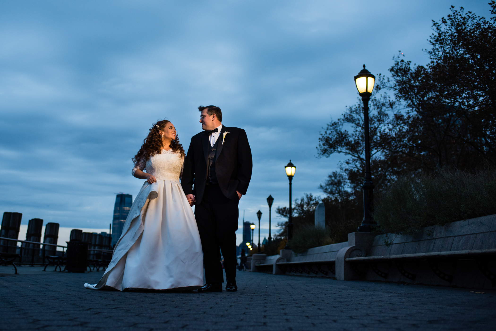Stefy Hilmer Photography-bride and groom walking in battery gardens.jpg