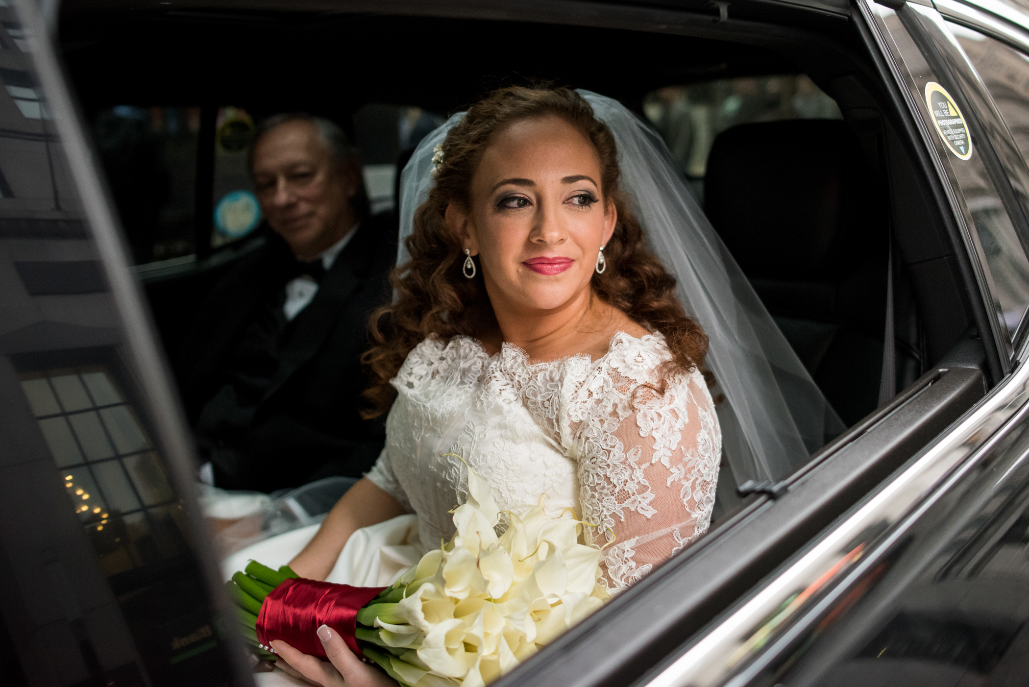 Stefy Hilmer Photography-bride is sitting in the car with his dad before church ceremony.jpg