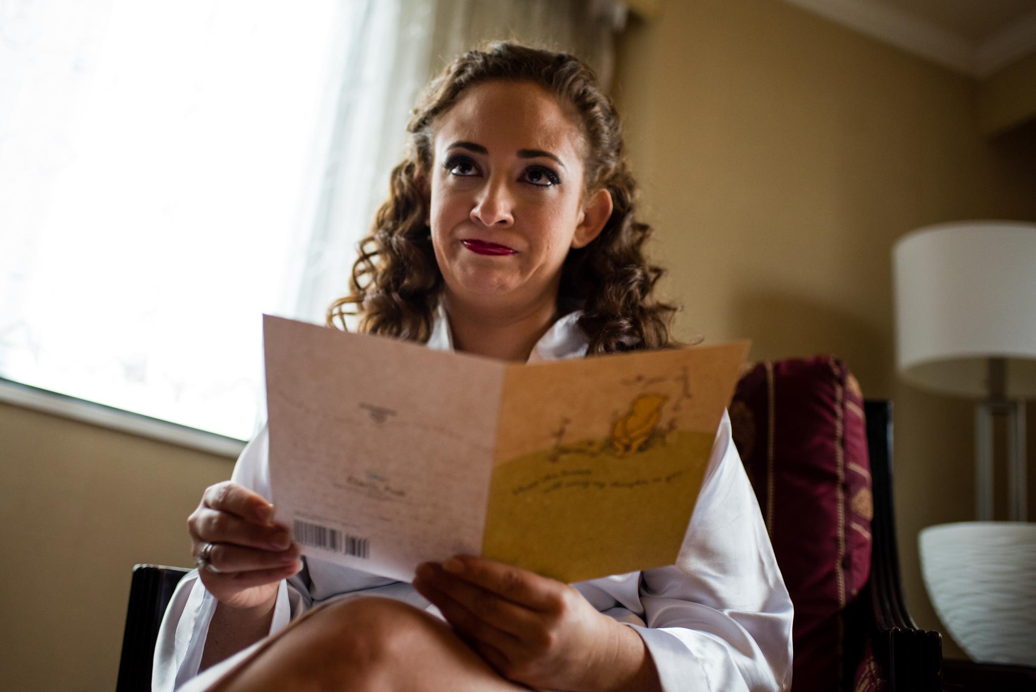 Stefy Hilmer Photography-bride reading grooms wedding card.jpg