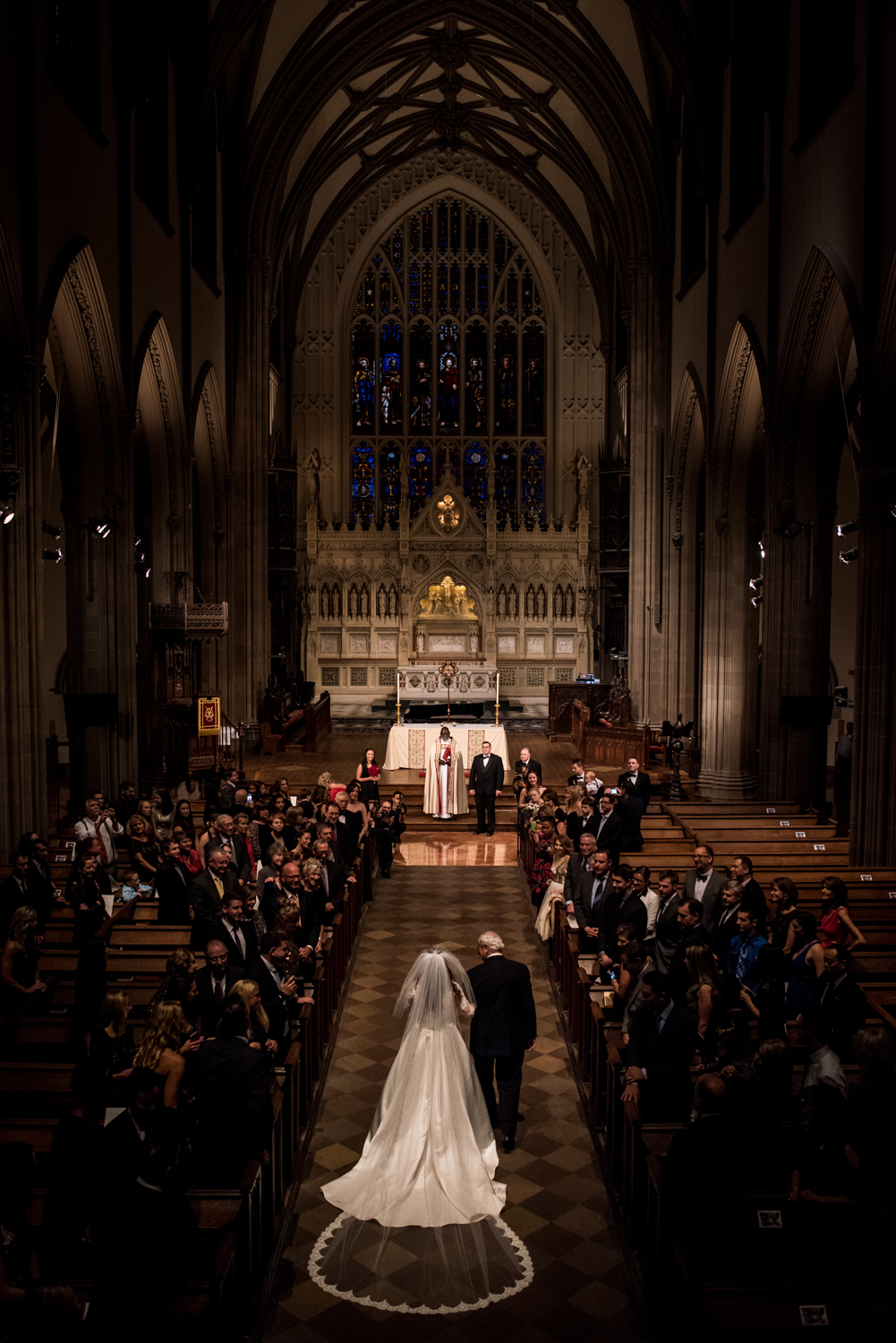Stefy Hilmer Photography-bride walking down the aisle with her dad at trinity church in NYC.jpg