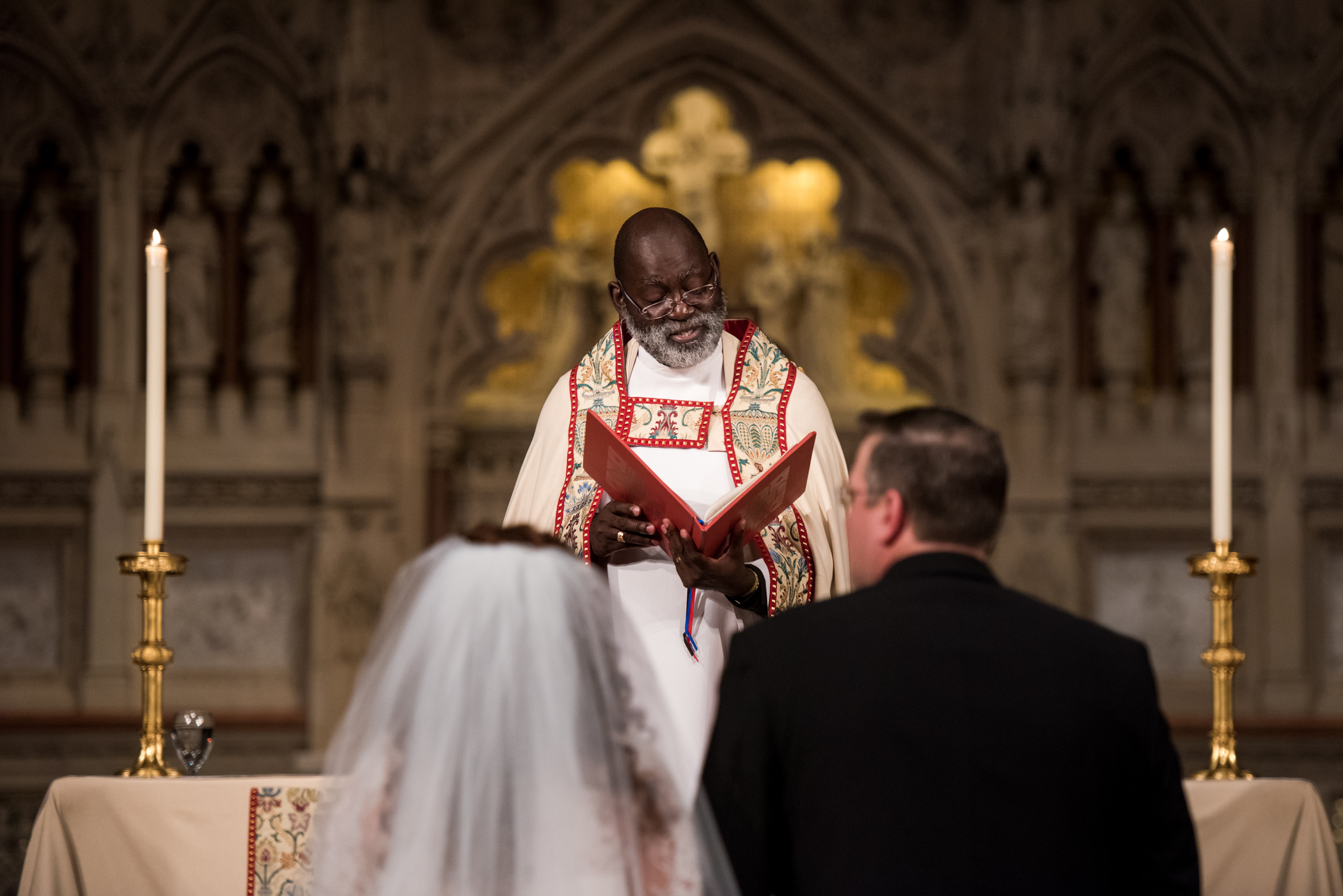 Stefy Hilmer Photography-groom is looking at his bride at trinity church.jpg
