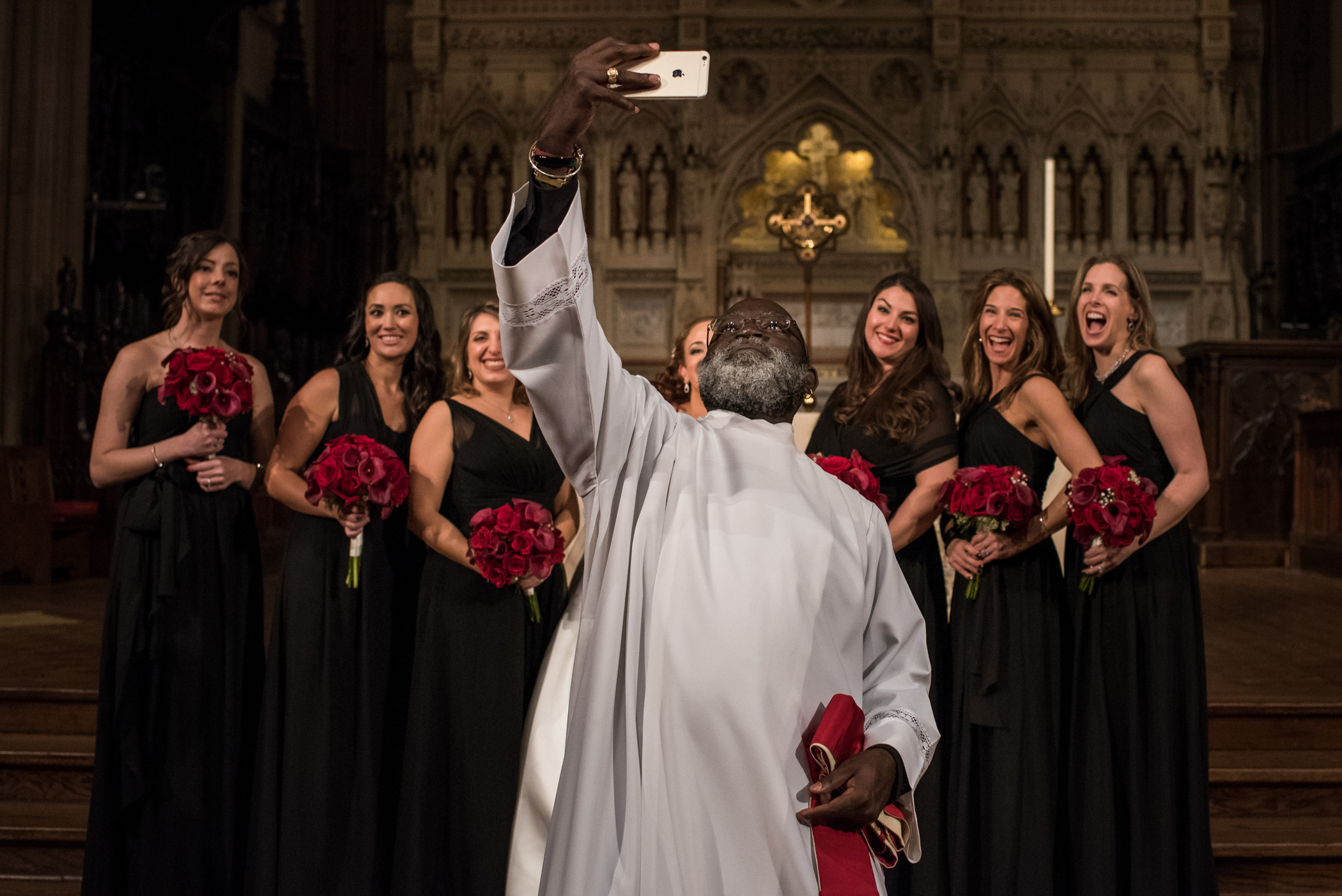 Stefy Hilmer Photography-priest jumping in front of the bridal party taking a selfie.jpg