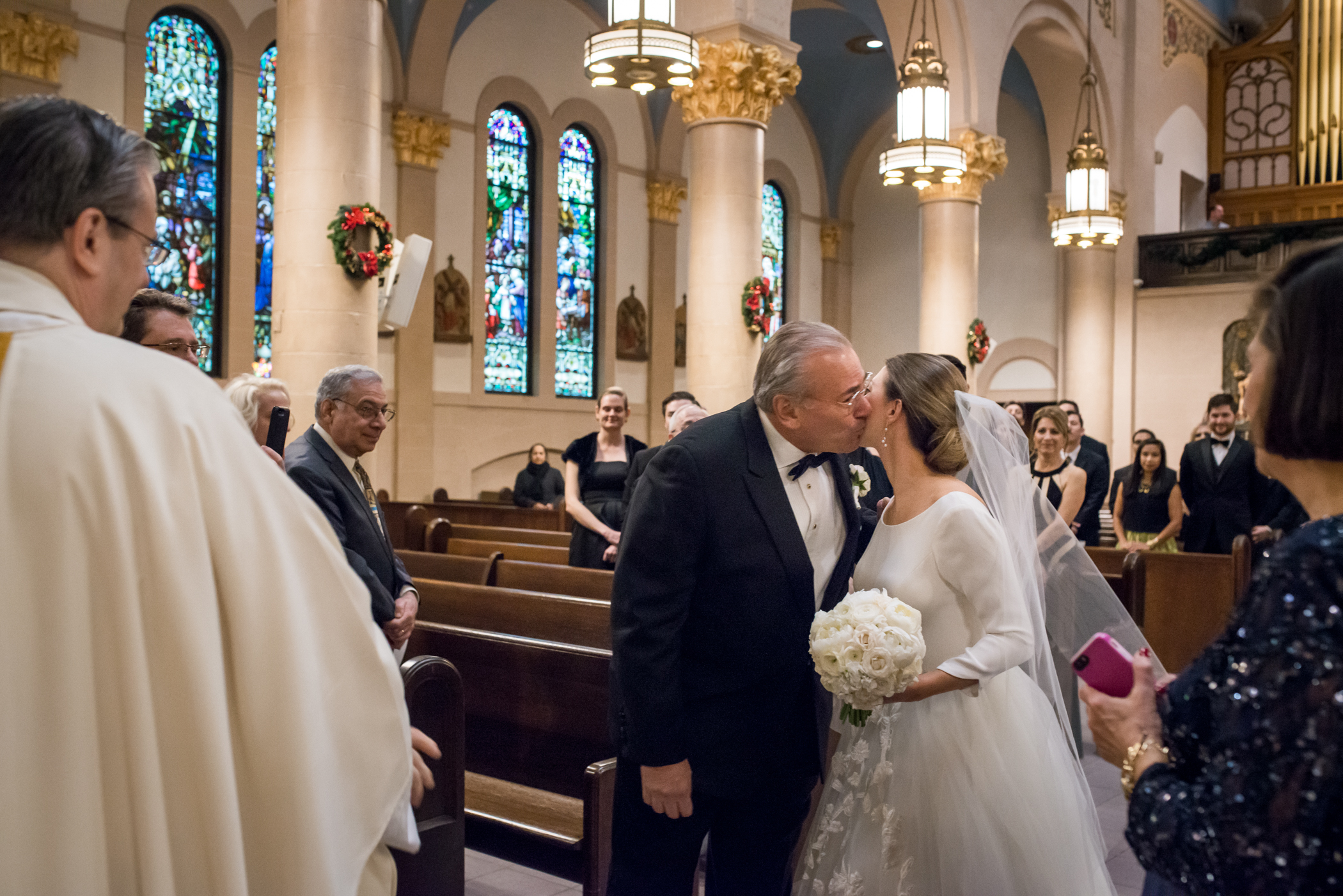 Stefy Hilmer Photography-dad is giving his daugher a kiss before giving her to her new husband.jpg