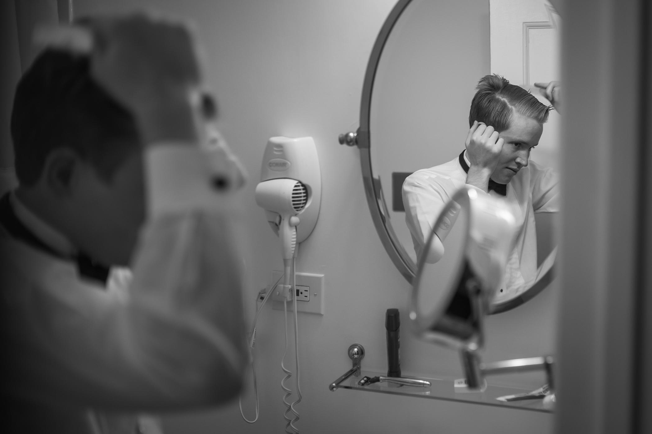 Stefy Hilmer Photography-groom is doing his hair.jpg