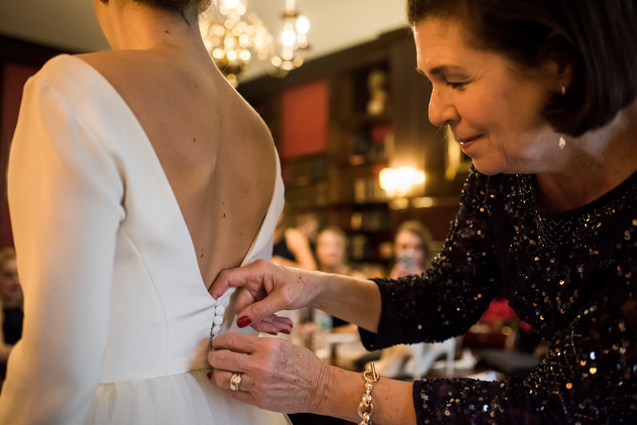 Stefy Hilmer Photography-mom is helping daughter into her wedding dress.jpg