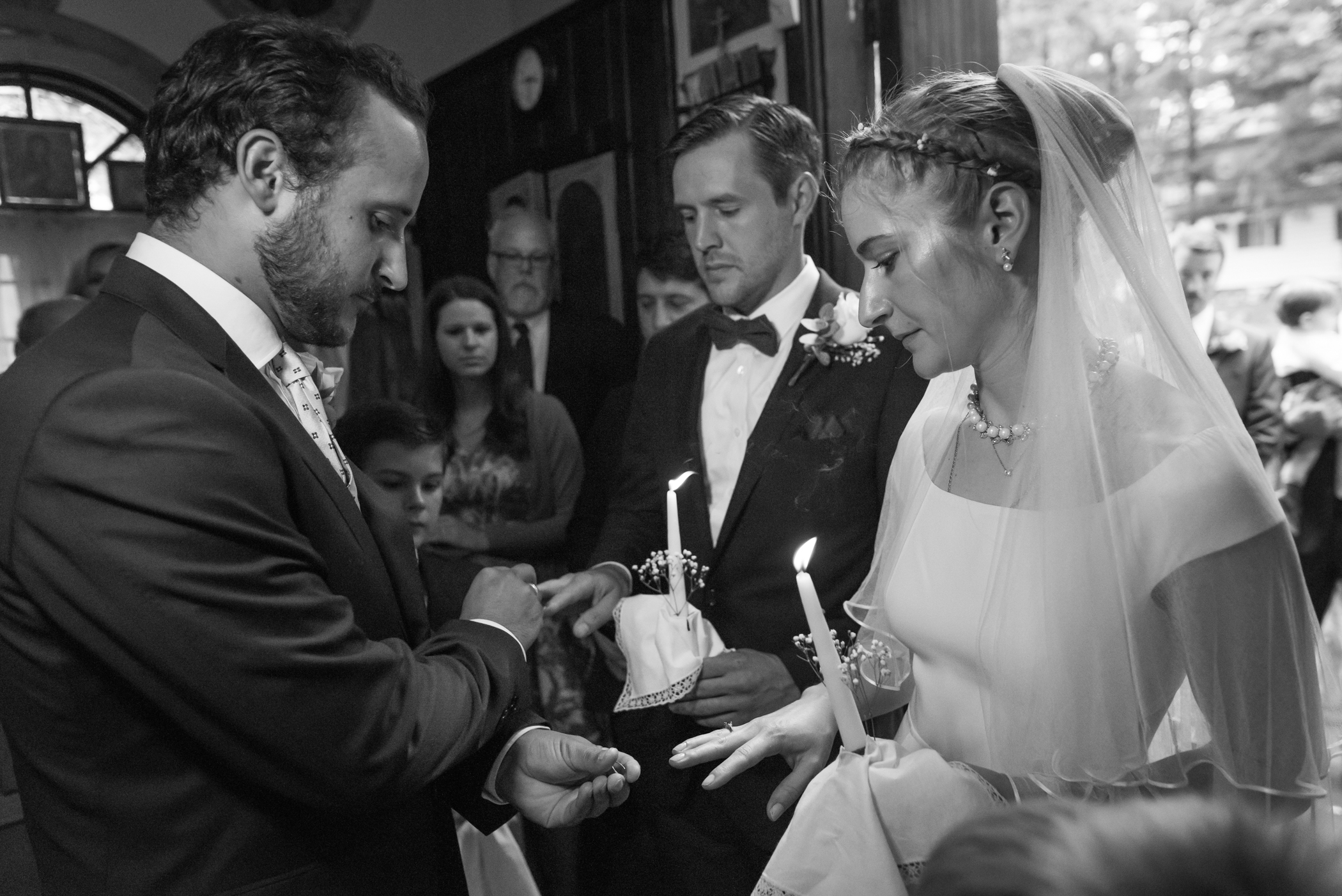 Stefy Hilmer Photography-brother of the groom is blessing the wedding rings.jpg