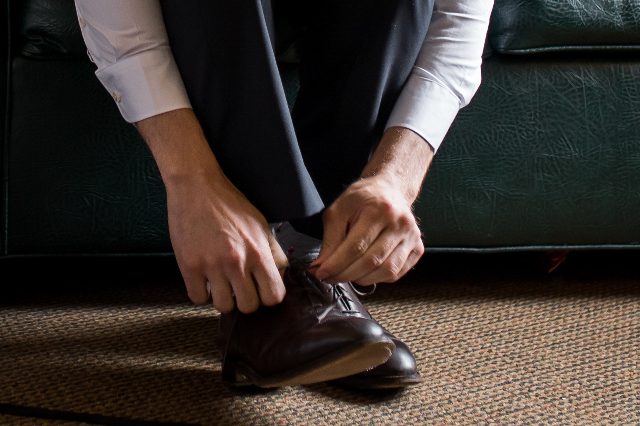Stefy Hilmer Photography-groom is putting on wedding shoes.jpg