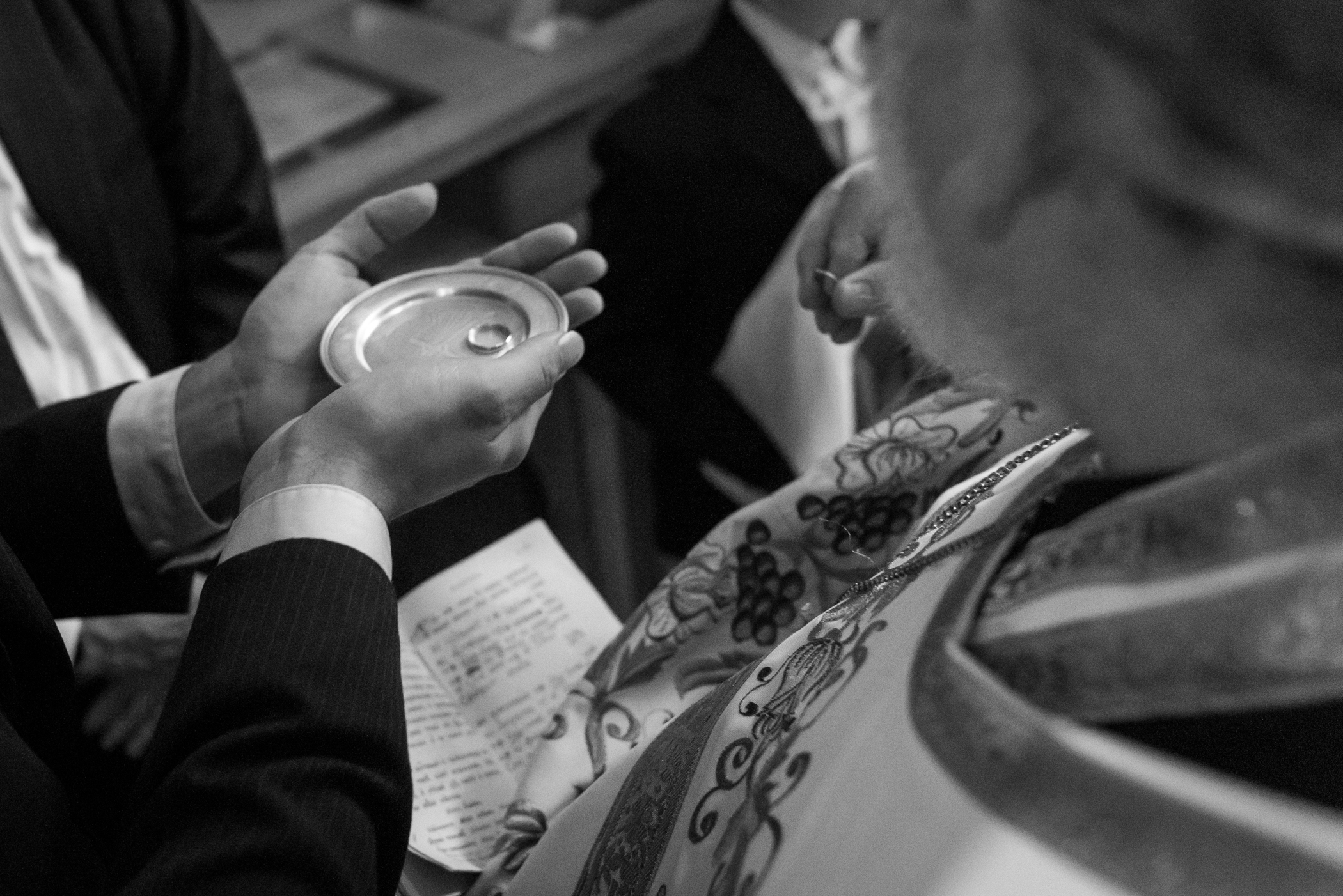 Stefy Hilmer Photography-usher carrying wedding rings.jpg