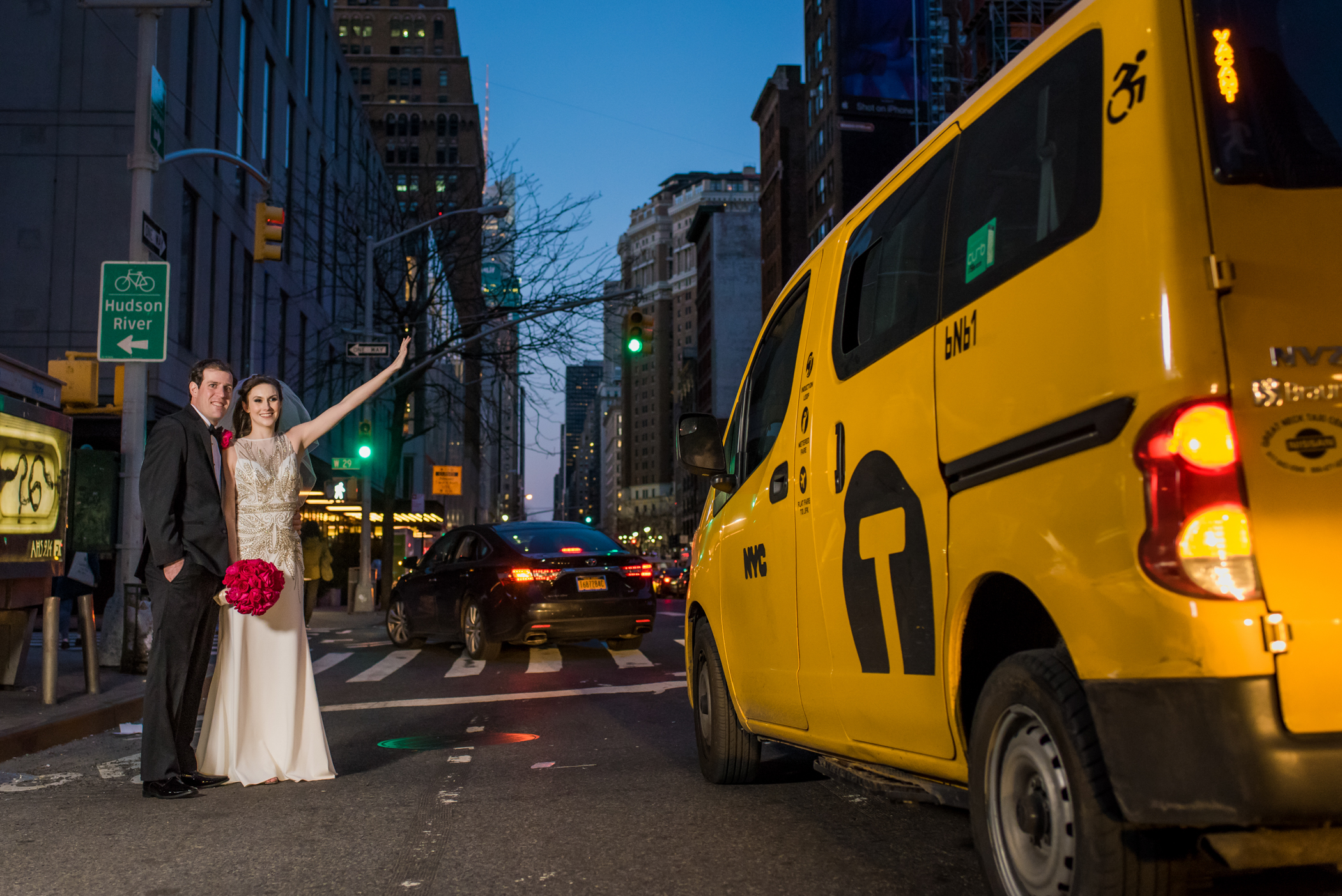 Stefy Hilmer Photography-bride and groom photo with NYC taxi.jpg