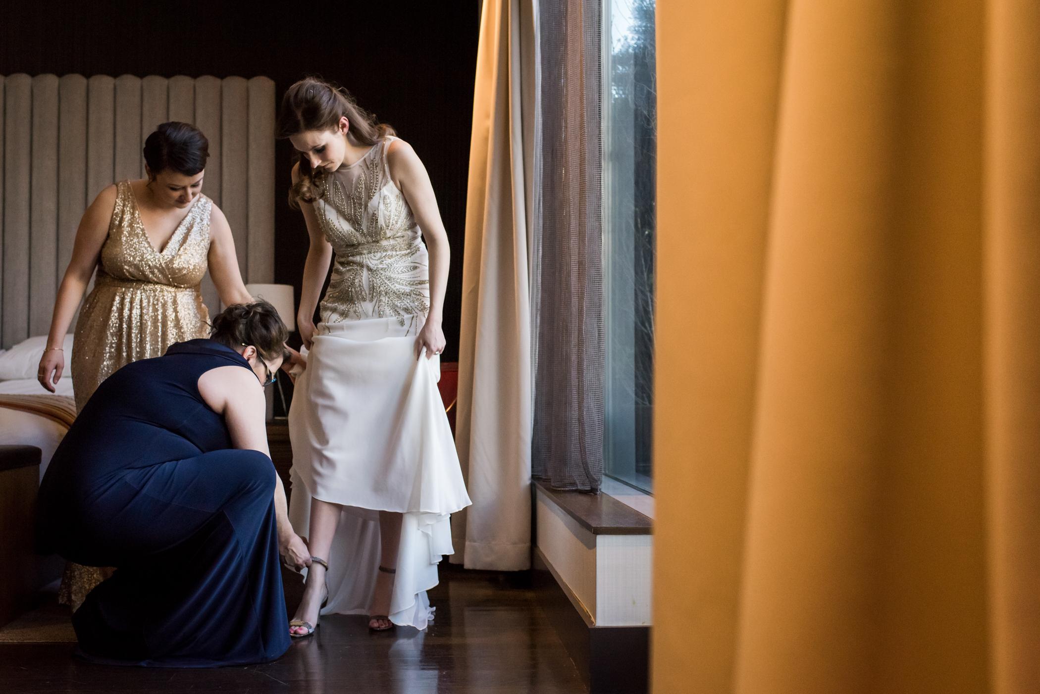 Stefy Hilmer Photography-bride getting into her wedding dress.jpg