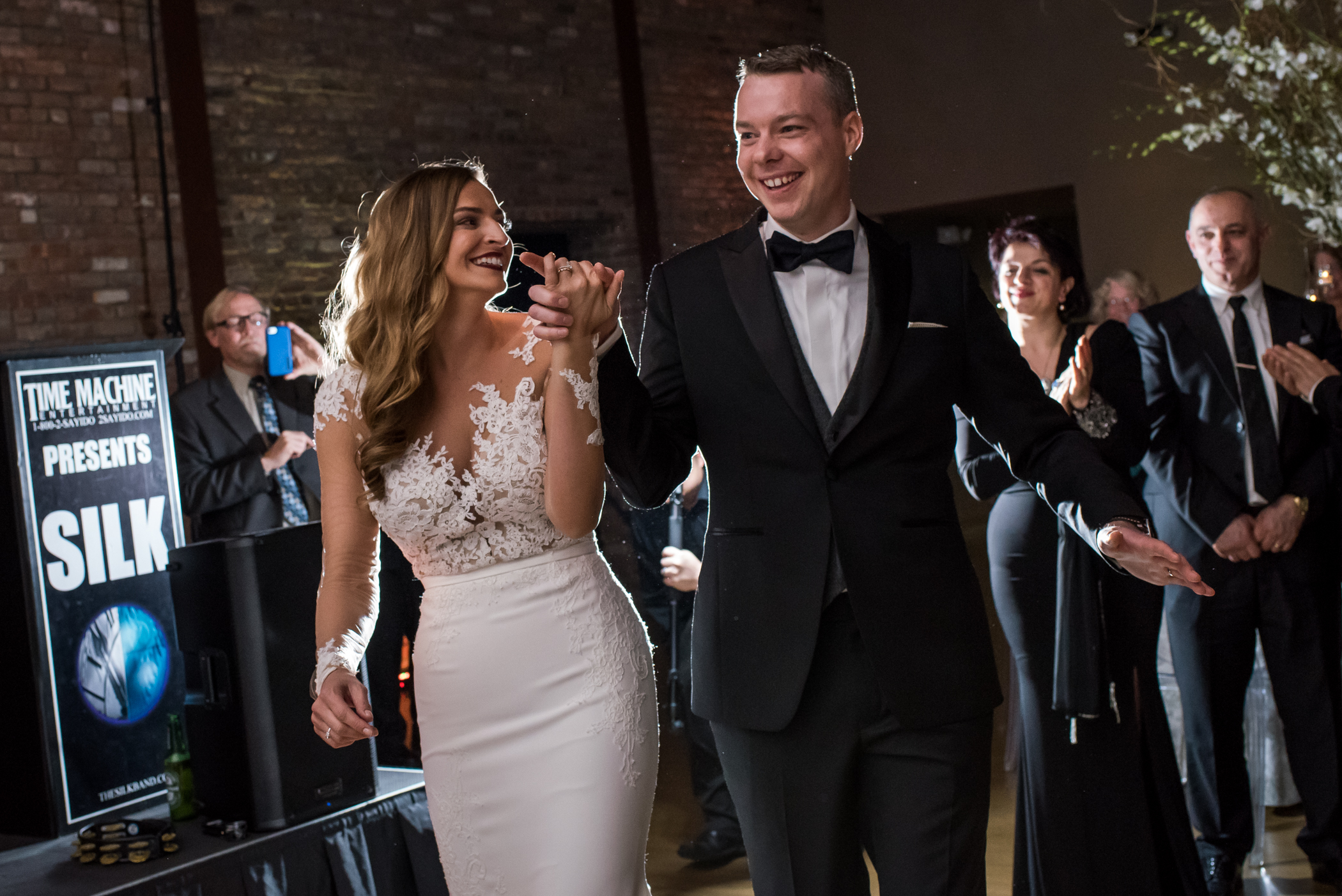 Stefy Hilmer Photography-bride and groom entering the reception hall at the Roundhouse in Beacon in NY.jpg