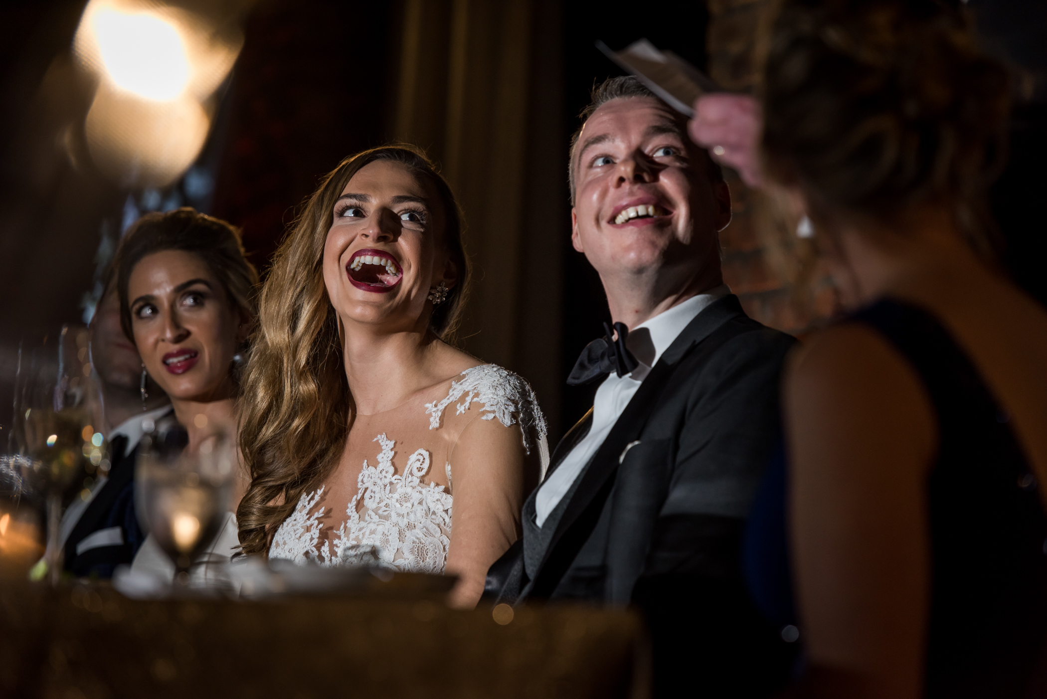 Stefy Hilmer Photography-bride and groom laughing listening to speeches.jpg
