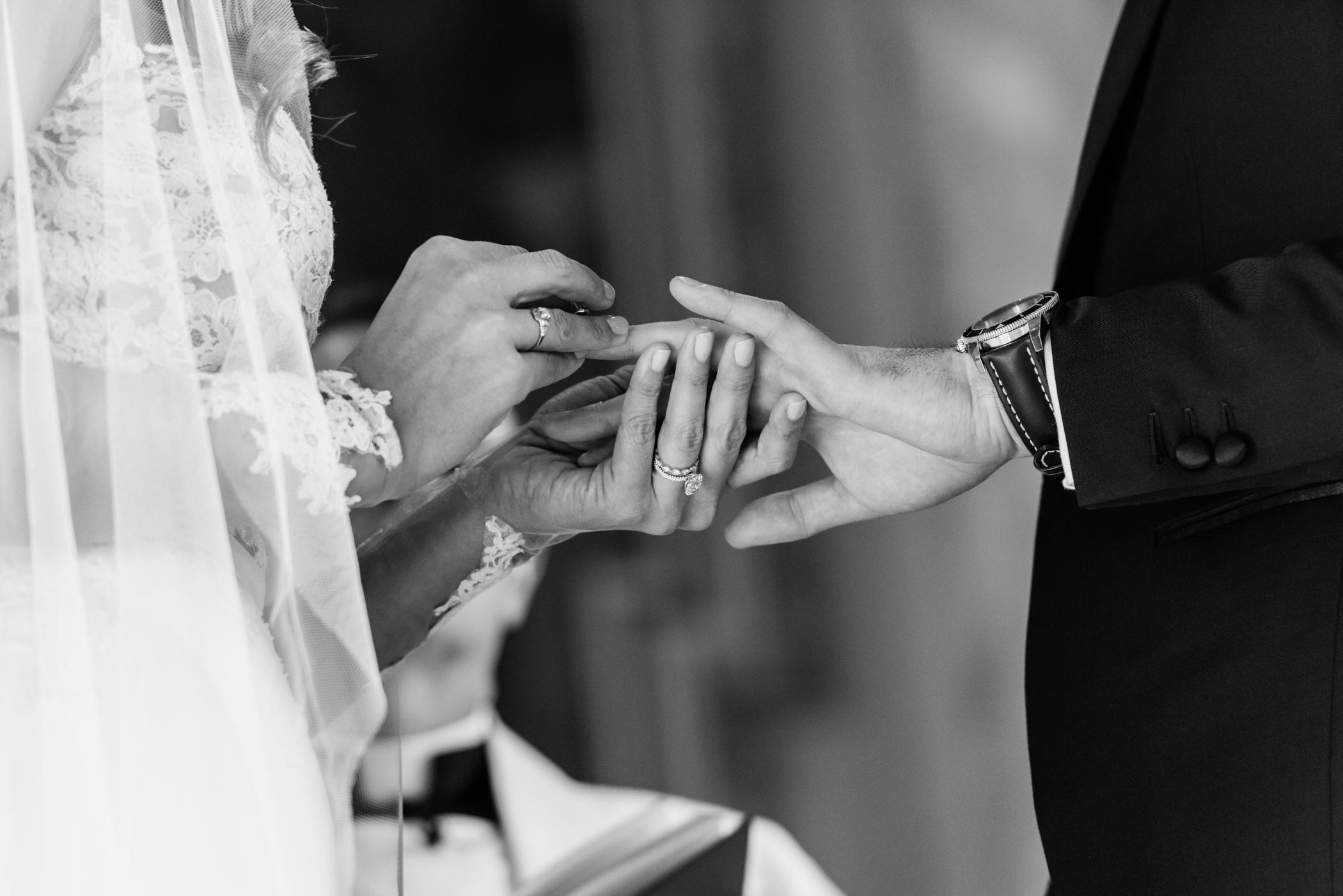 Stefy Hilmer Photography-bride is putting ring on her husbands finger.jpg