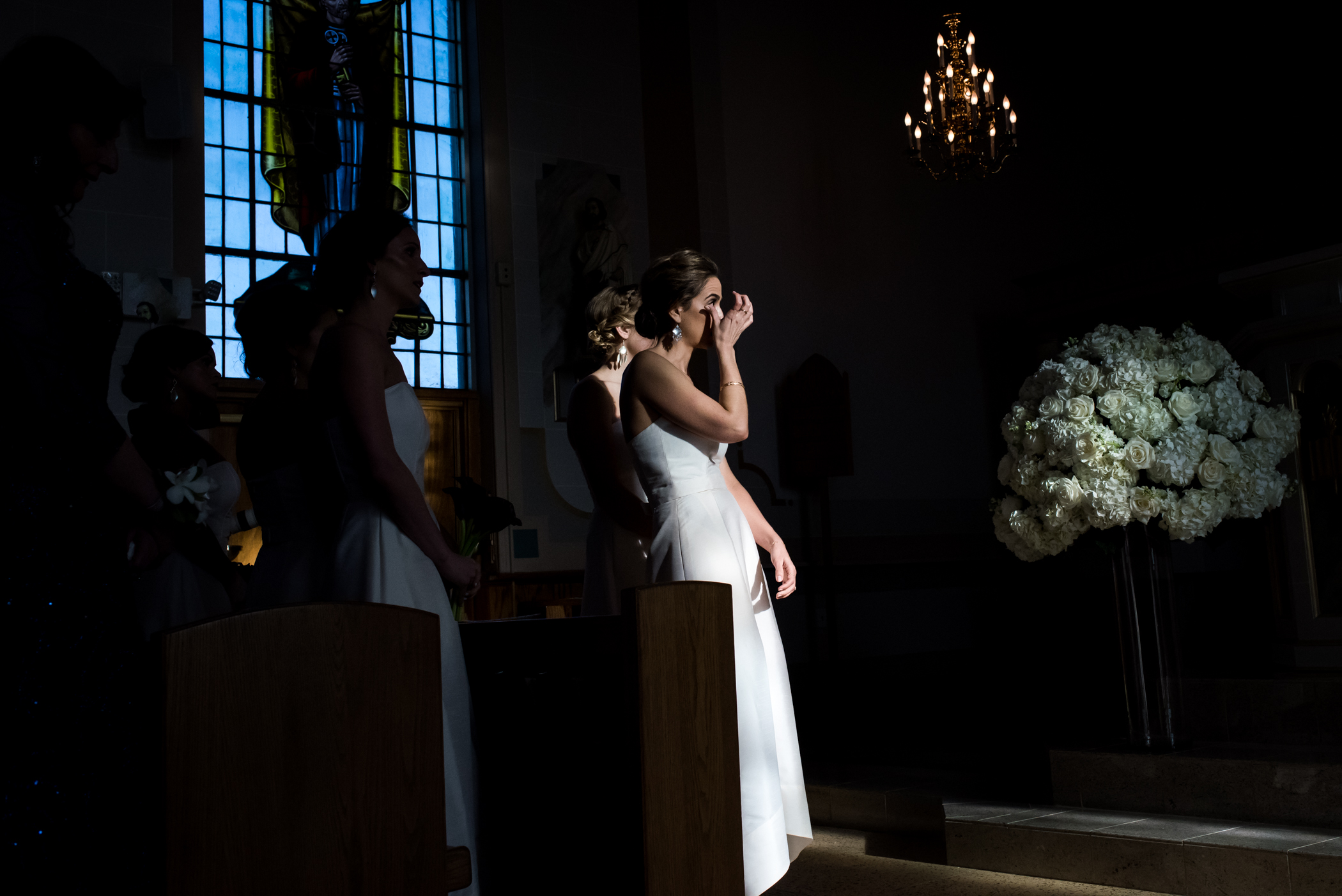 Stefy Hilmer Photography-bridesmaid crying during church ceremony.jpg