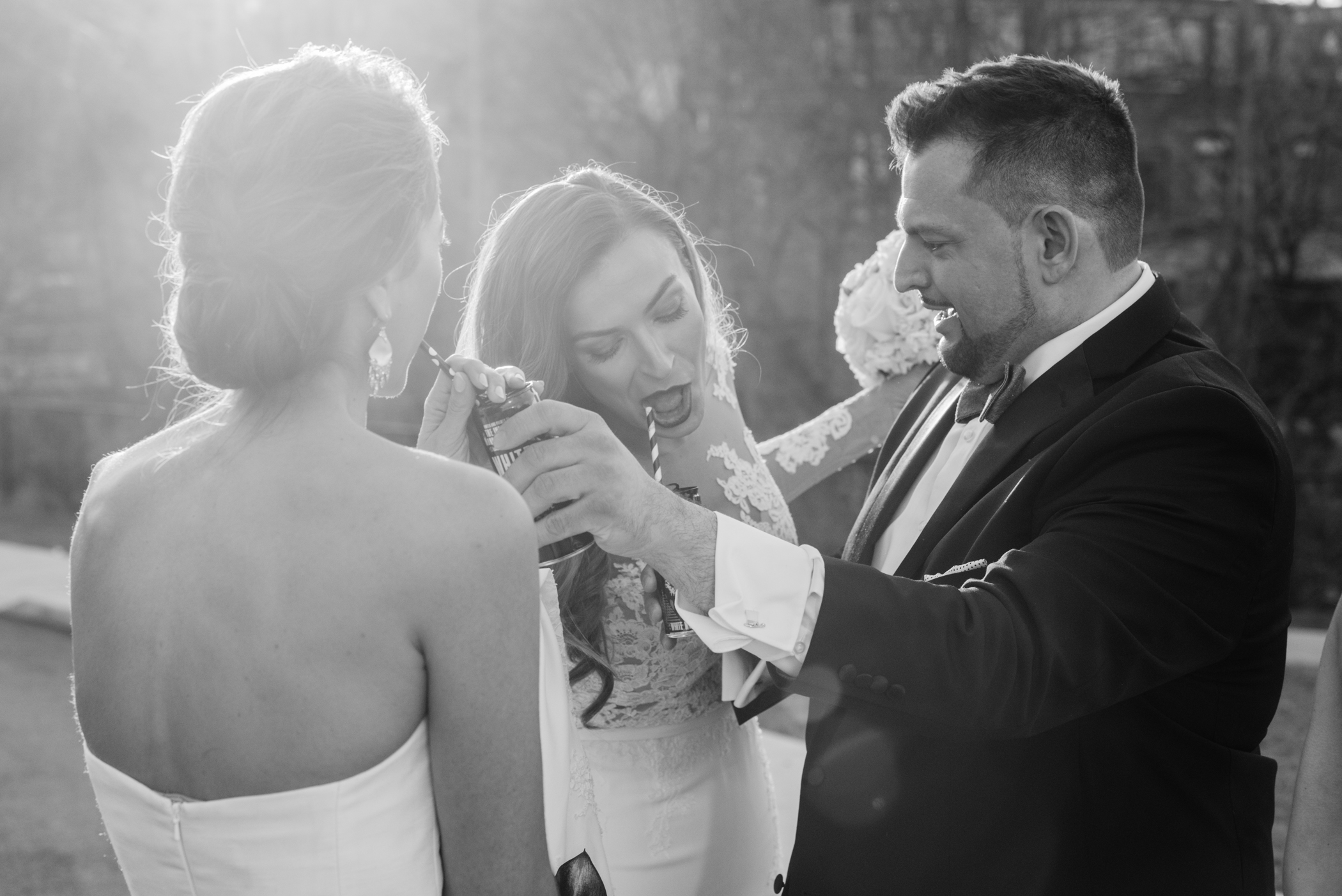 Stefy Hilmer Photography-brother of the bride is helping her staying hydrated.jpg