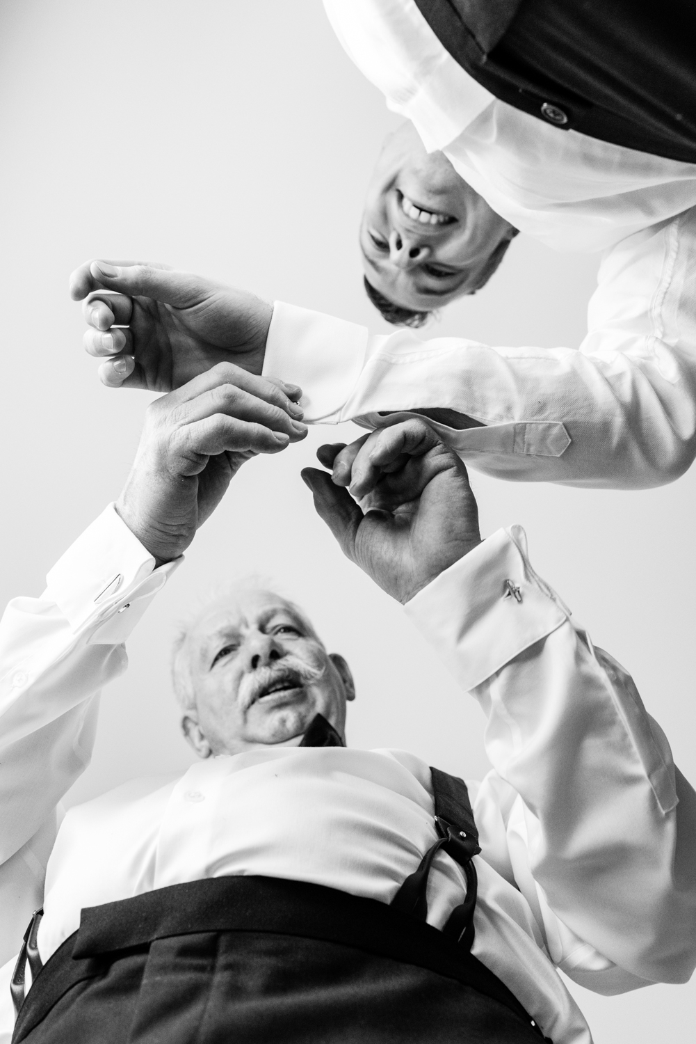 Stefy Hilmer Photography-dad is helping groom to get ready and put cufflings on.jpg