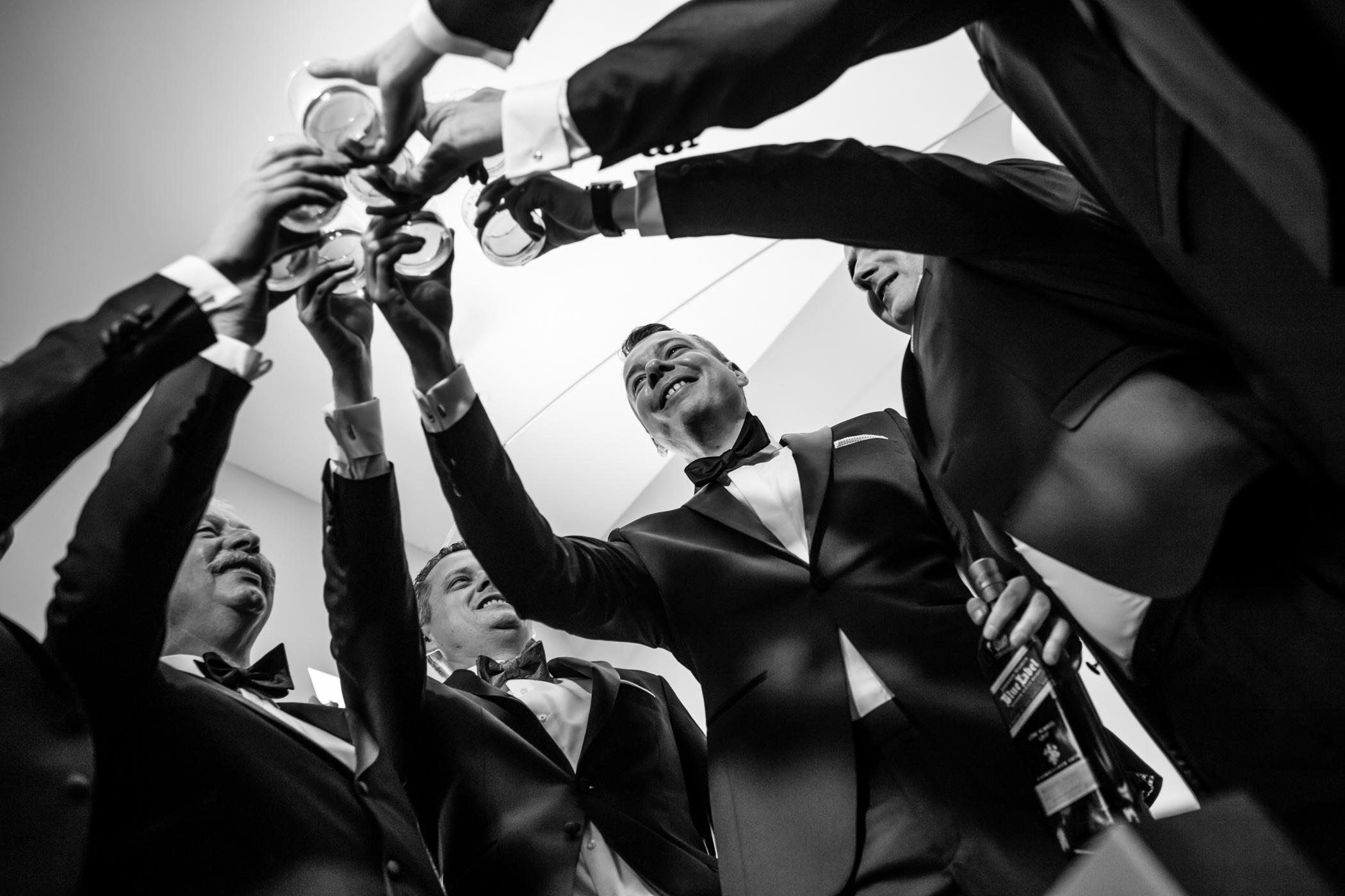 Stefy Hilmer Photography-groom is cheering with his groomsmen.jpg