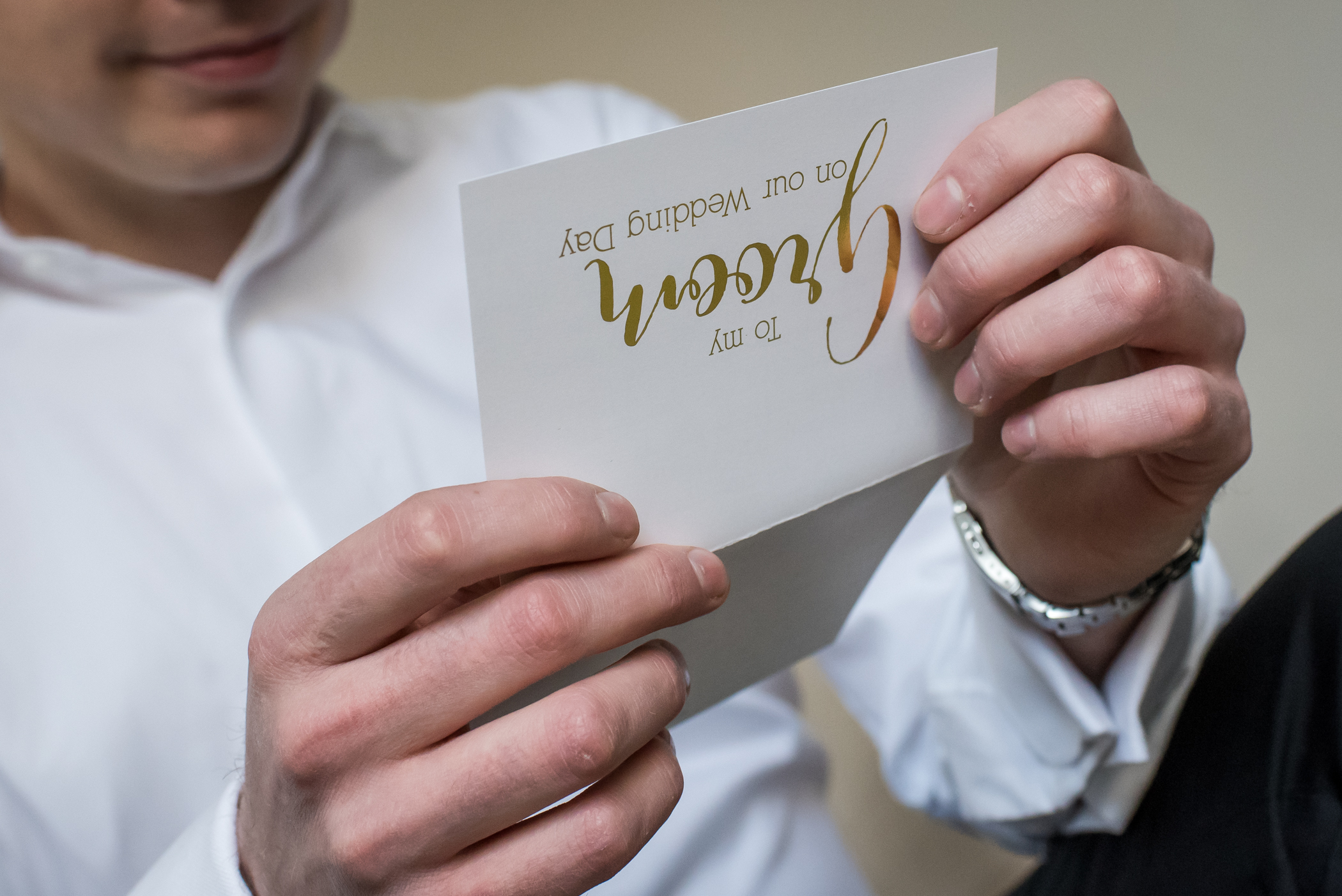 Stefy Hilmer Photography-groom is reading card from his bride.jpg