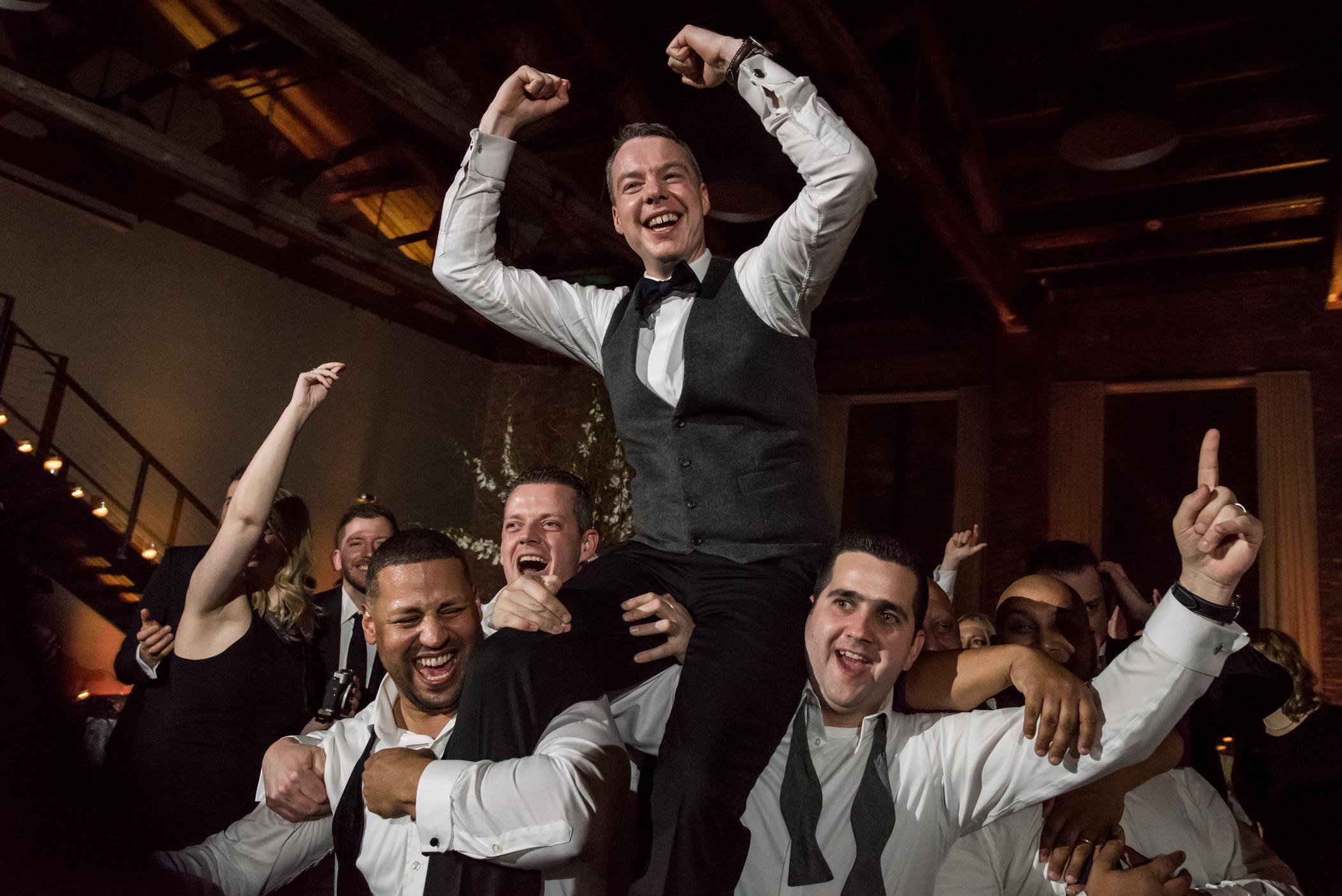 Stefy Hilmer Photography-groom riding on groomsmen shoulders.jpg